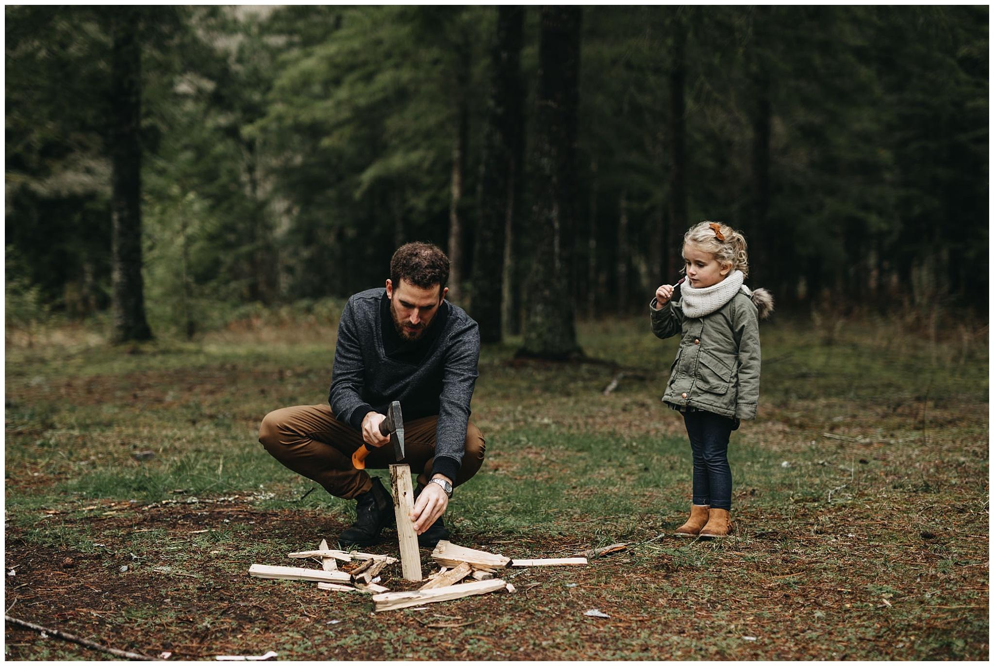 dad chopping firewood daughter watching family photos chilliwack