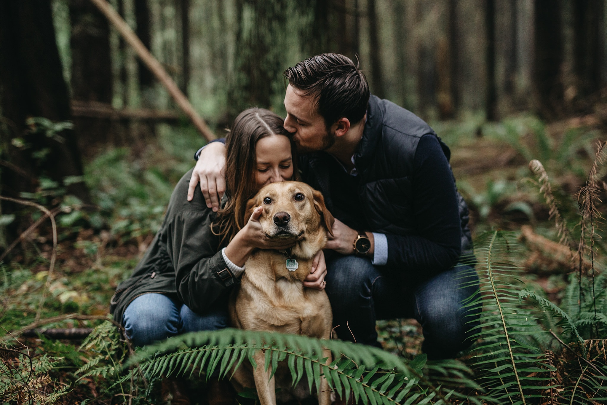 couple kissing dog engagement photos pacific spirit park forest trees