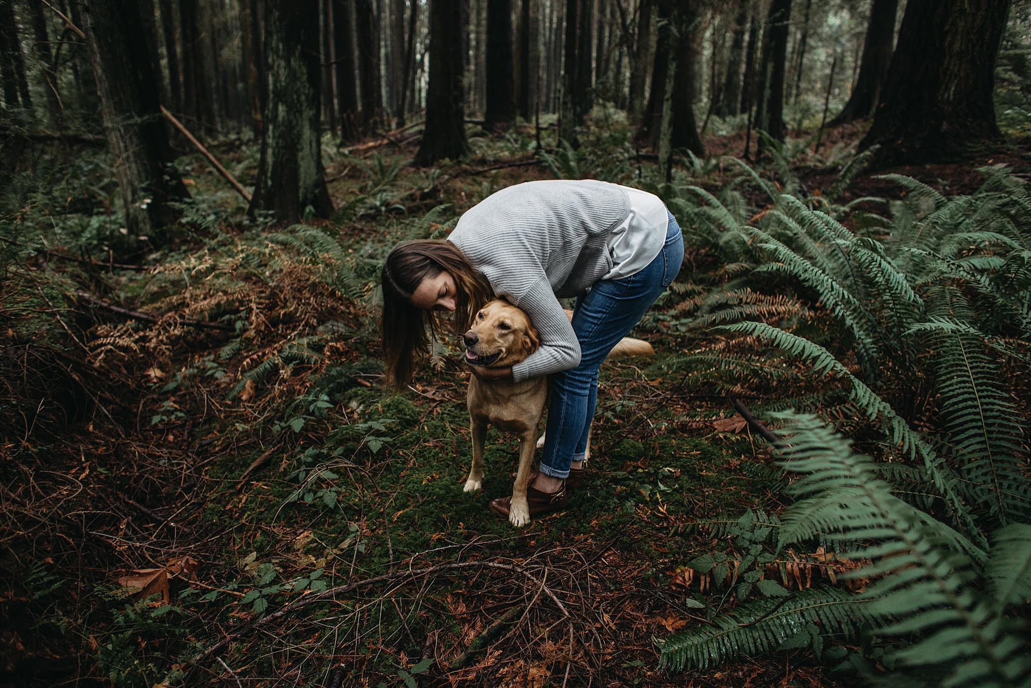 girl kissing dog engagement photos pacific spirit park forest