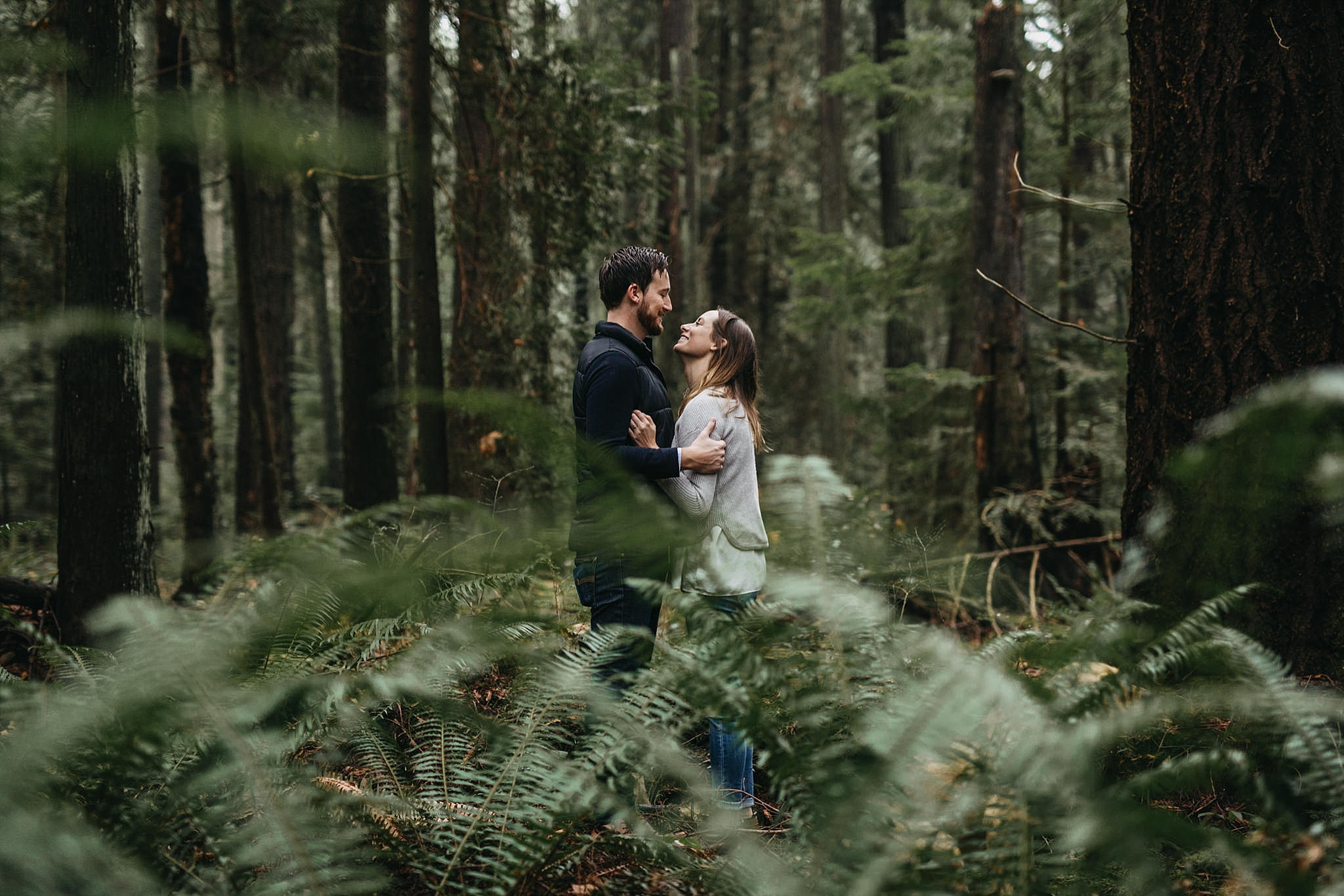 couple in ferns forest pacific spirit park engagement