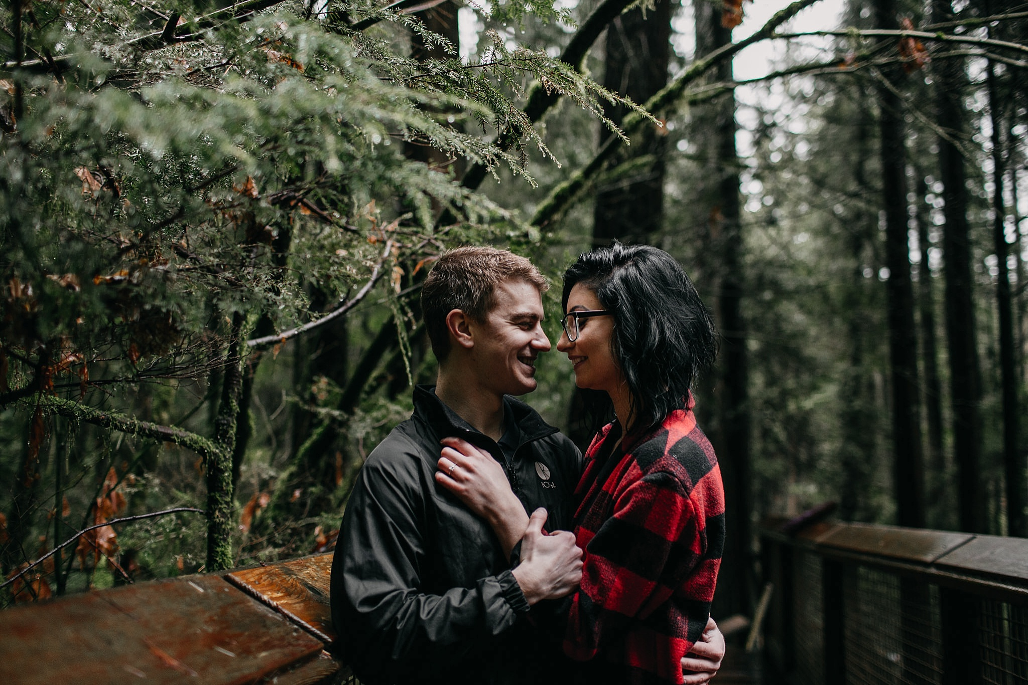 couple intimate moment capilano suspension bridge engagement photos
