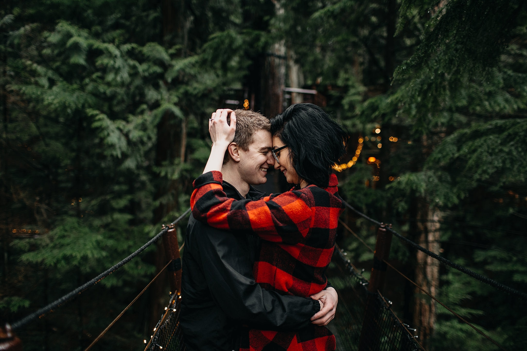 couple hugging close capilano suspension bridge engagement