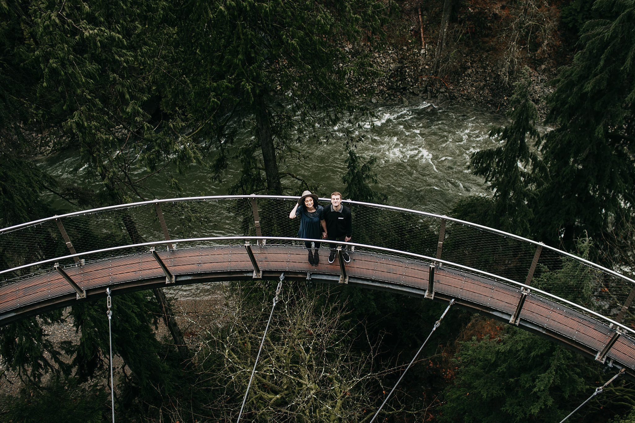couple looking up on cliff walk capilano suspension bridge north vancouver engagement