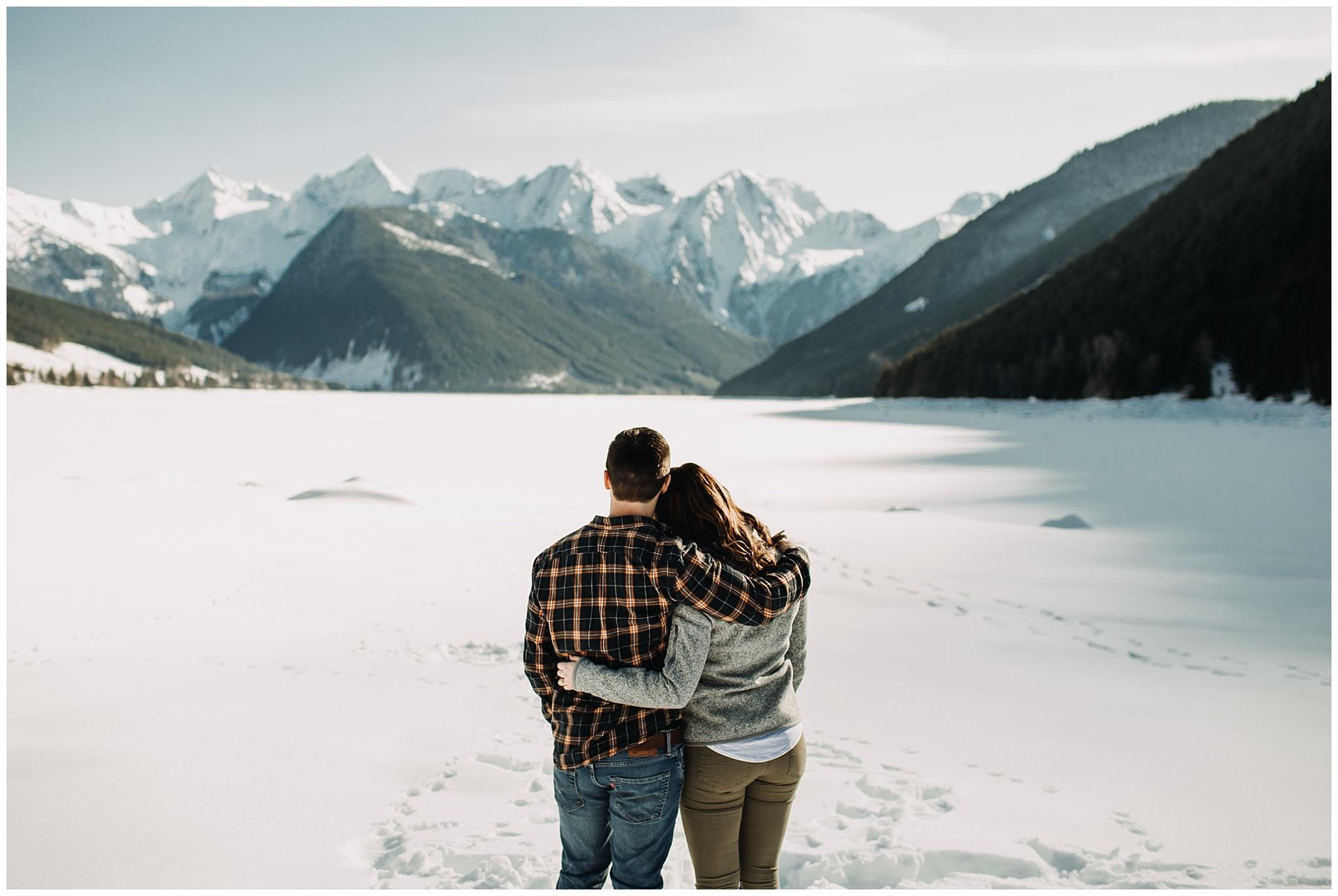 couple enjoying view of mountains at snowy jones lake