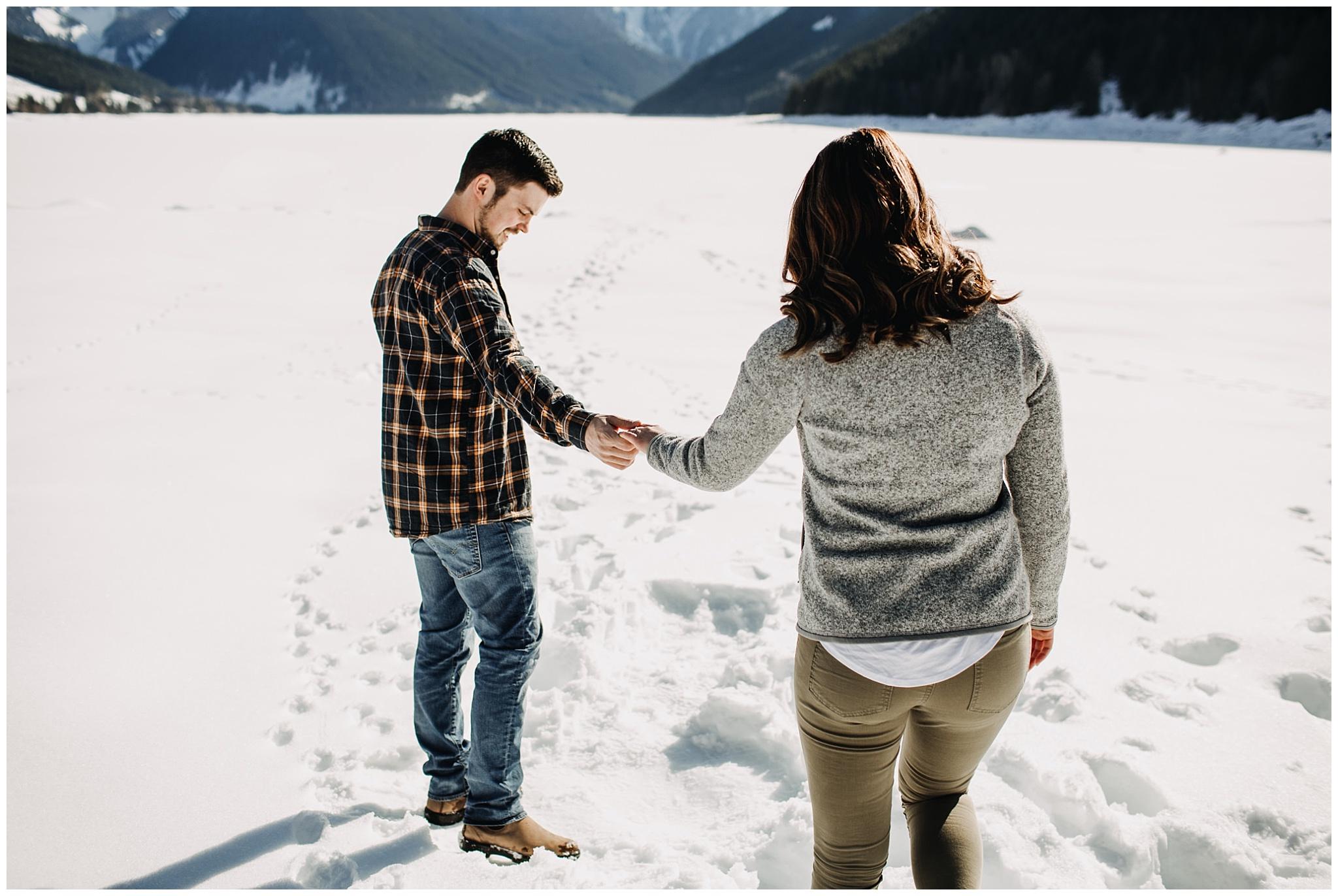 couple walking on snow jones lake chilliwack engagement