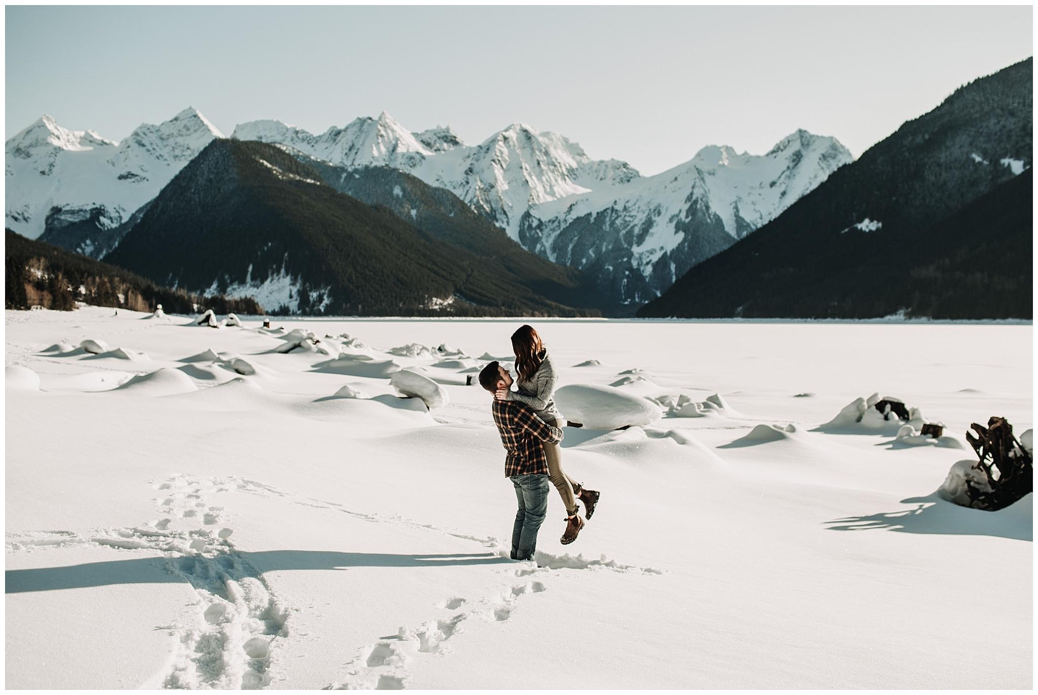 jones lake chilliwack engagement session guy picking up girl snowy sunny