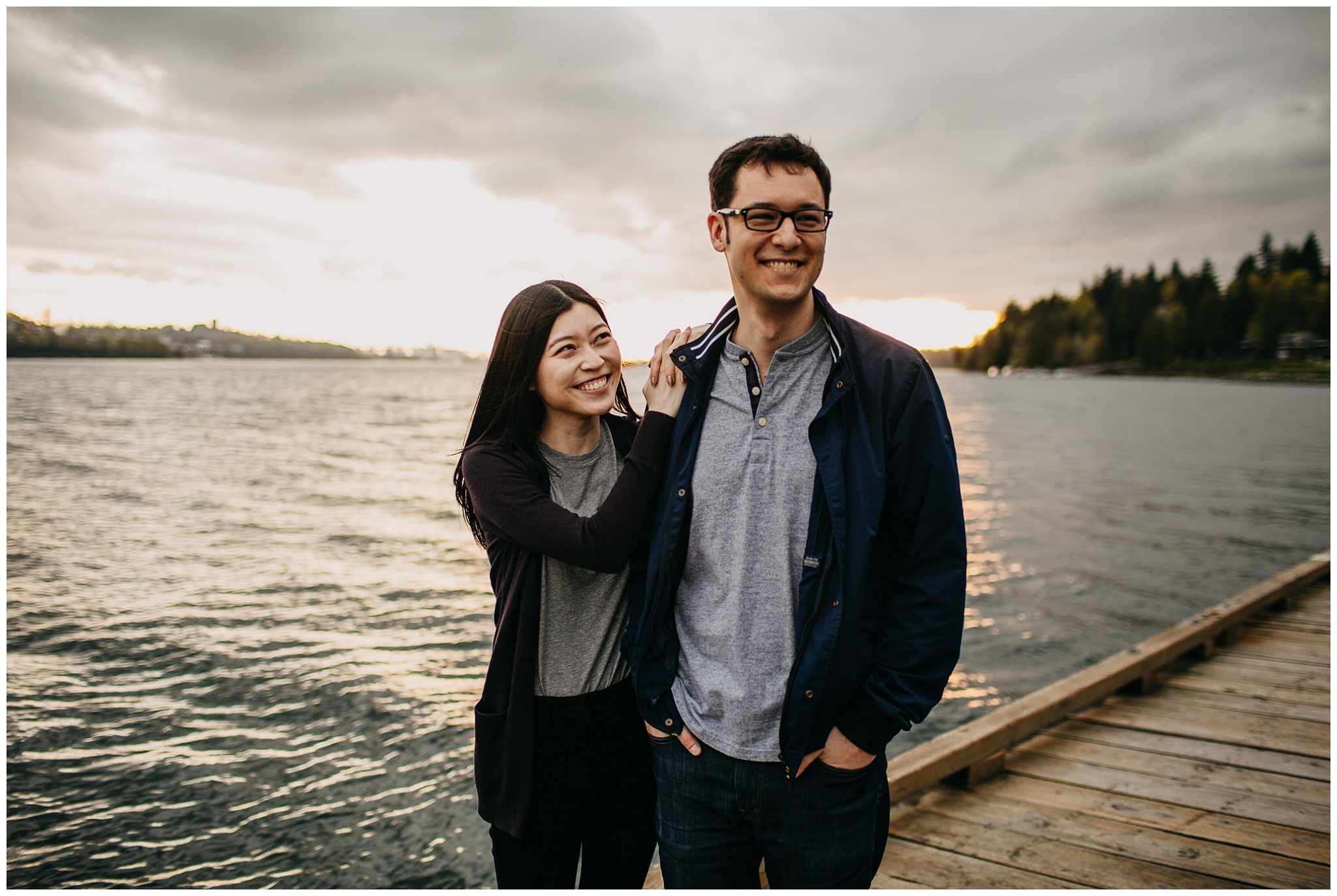 couple laugh candid engagement photos north vancouver cates park golden sunset
