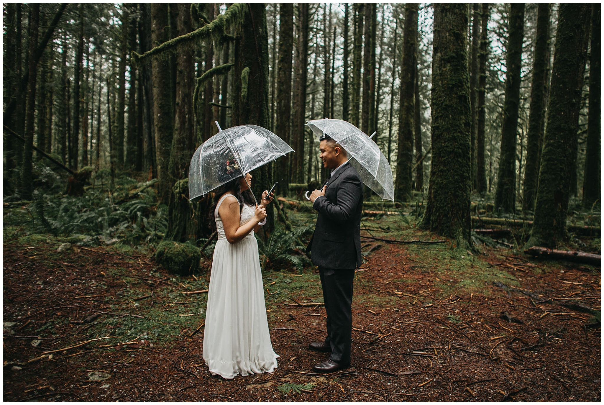 bride groom reading private vows in forest rainy intimate wedding goldn ears