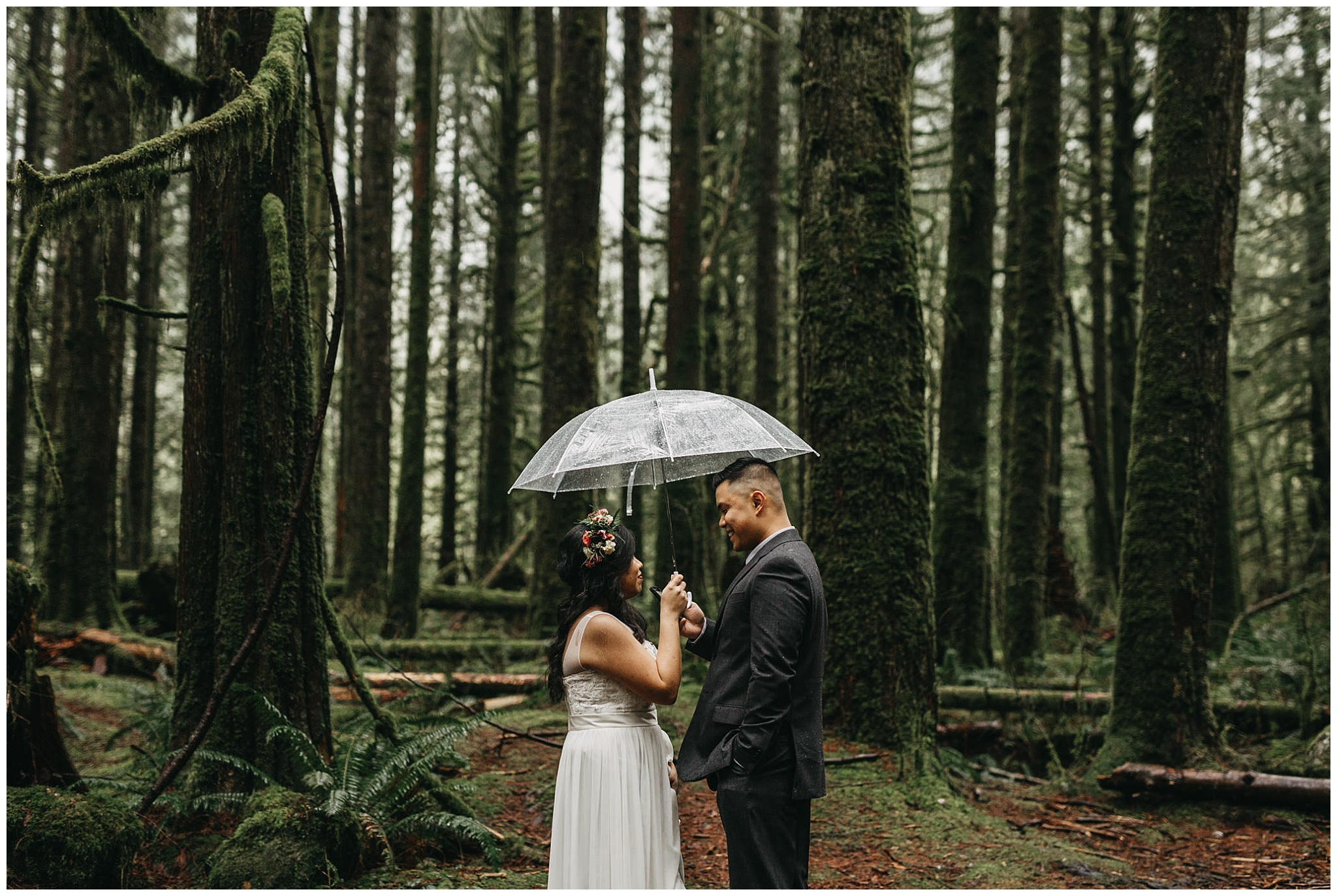groom reading vows to bride in mossy forest rainy intimate wedding golden ears park