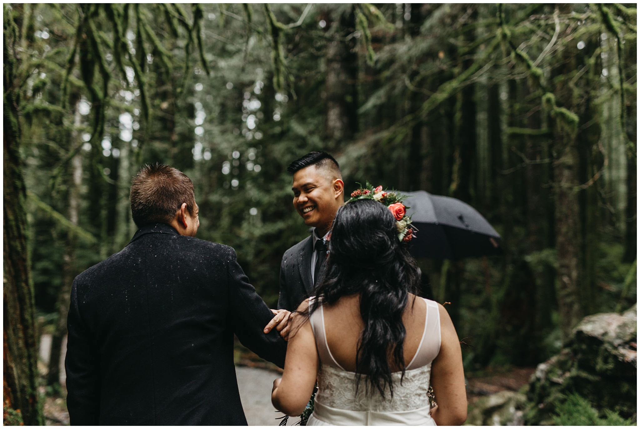groom shaking father of bride's hand ceremony forest intimate golden ears wedding