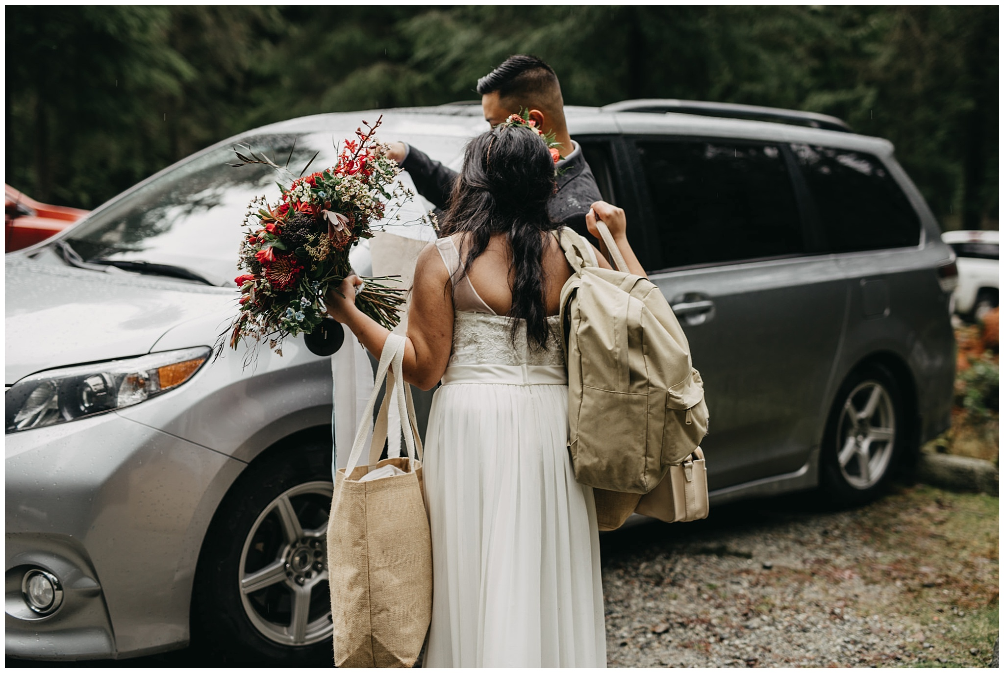 laid back bride carrying own bags at wedding forest intimate ceremony golden ears