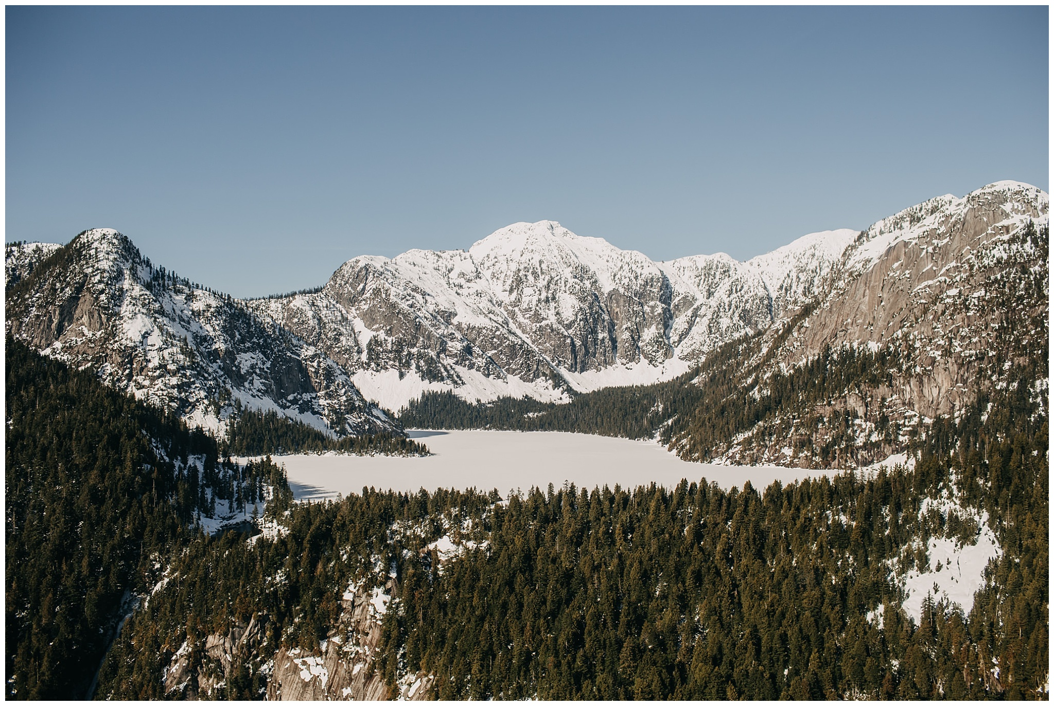 sky helicopters snowy mountain wedding couple portraits