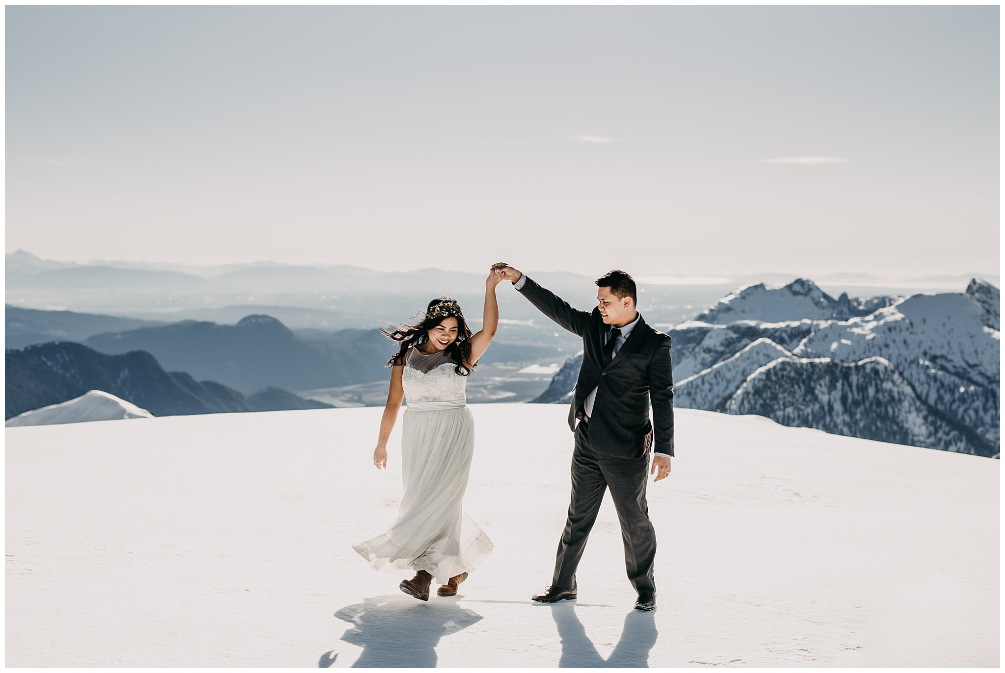 bride groom dancing on mountaintop snow sky helicopters wedding