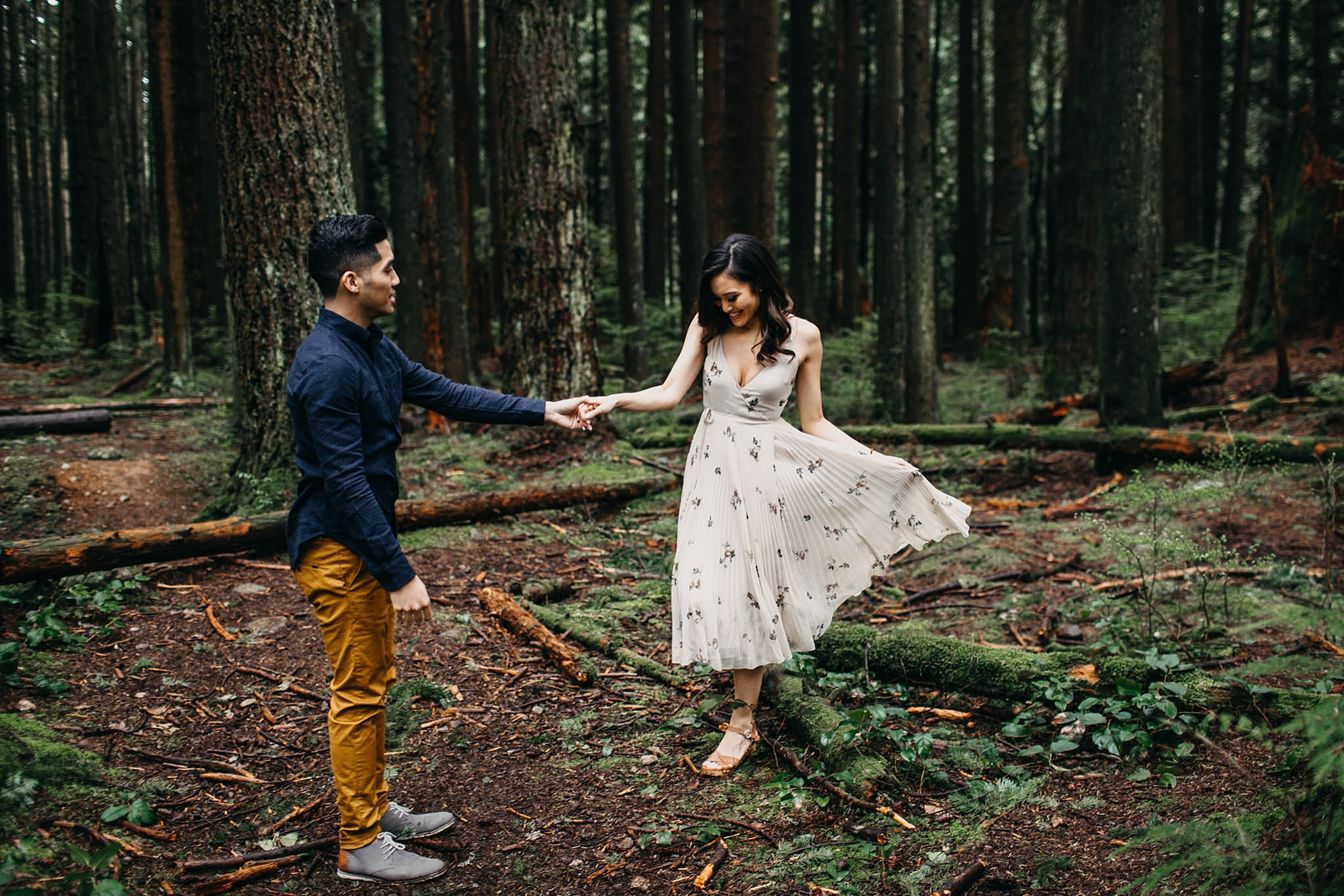 couple dancing in forest flowy boho dress pacific spirit park engagement