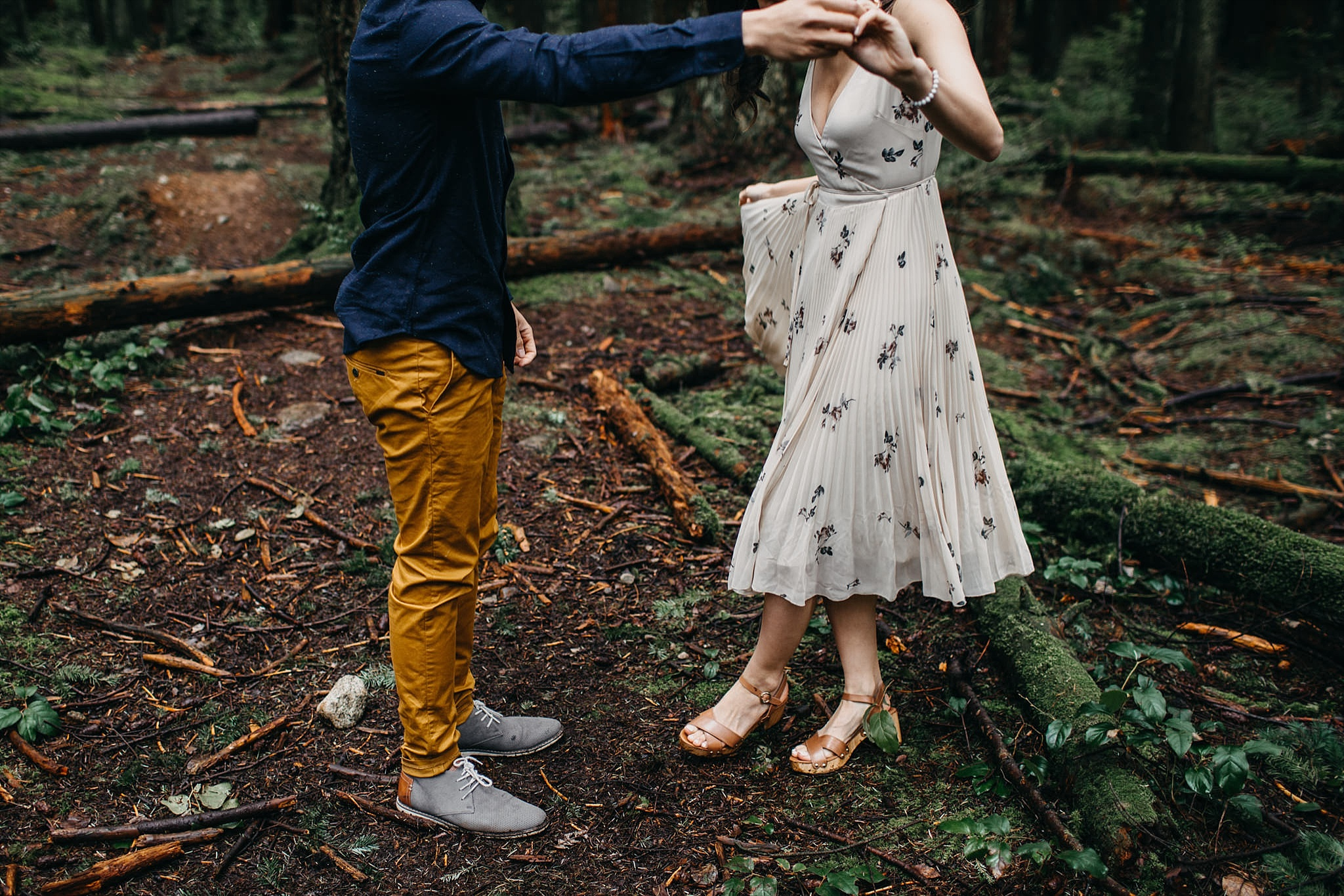 couple dancing feet in forest engagement session vancouver pacific spirit park