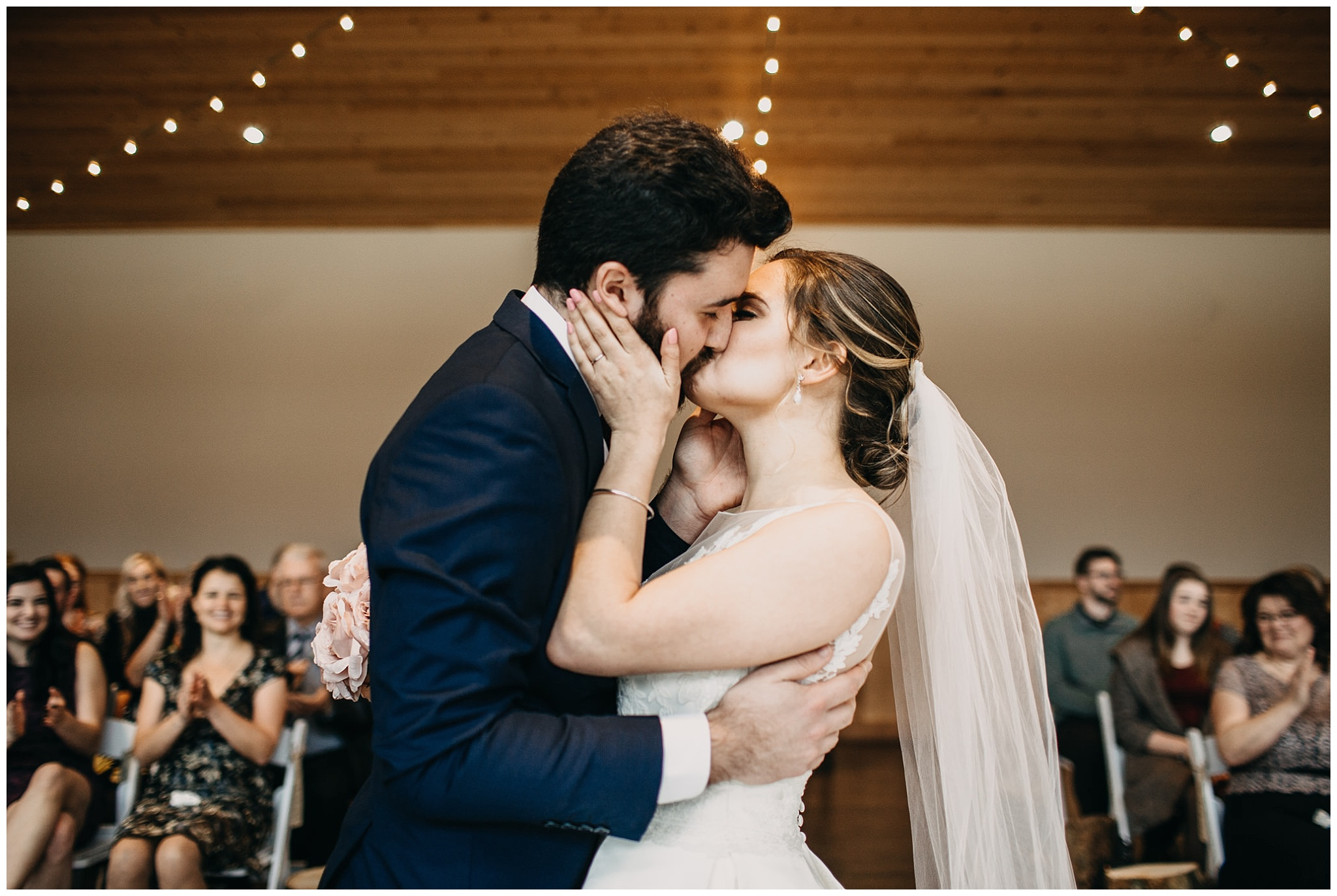 bride and groom first kiss at fraser river lodge wedding