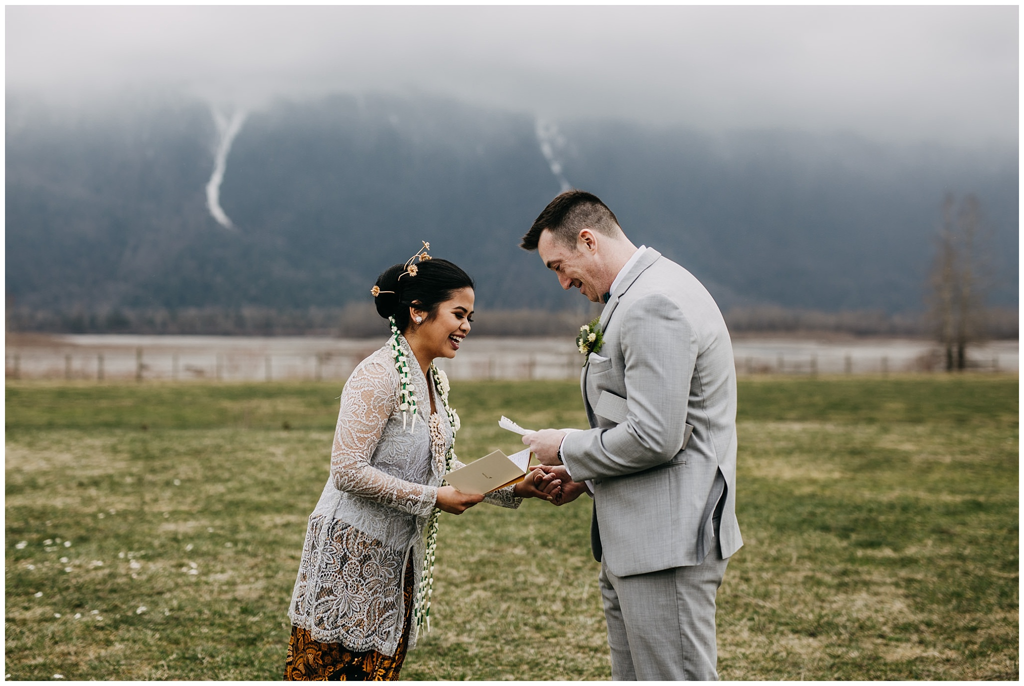 bride and groom reading letters at first look at fraser river lodge wedding