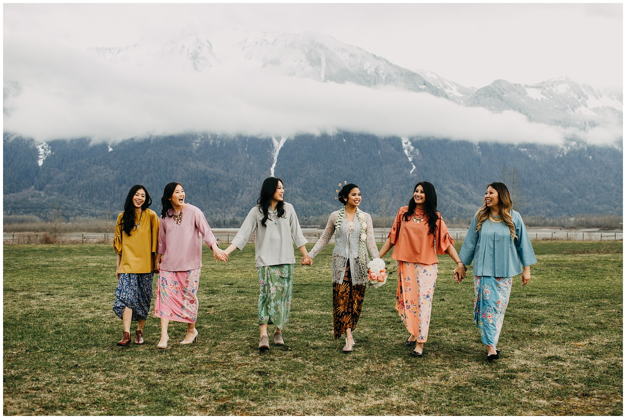 bride and bridesmaids in cultural gowns at fraser river lodge wedding