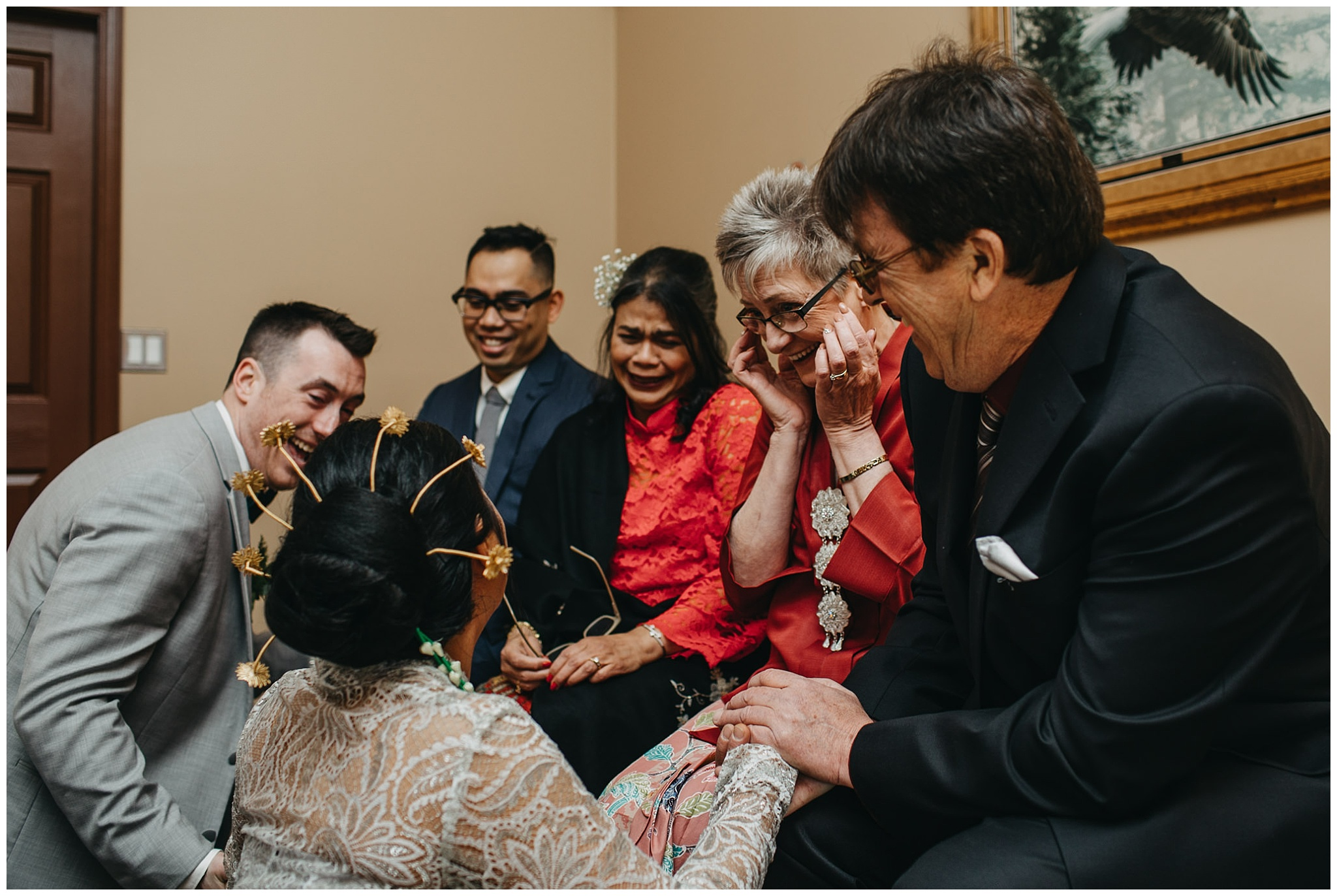 emotional moment with bride and groom and parents