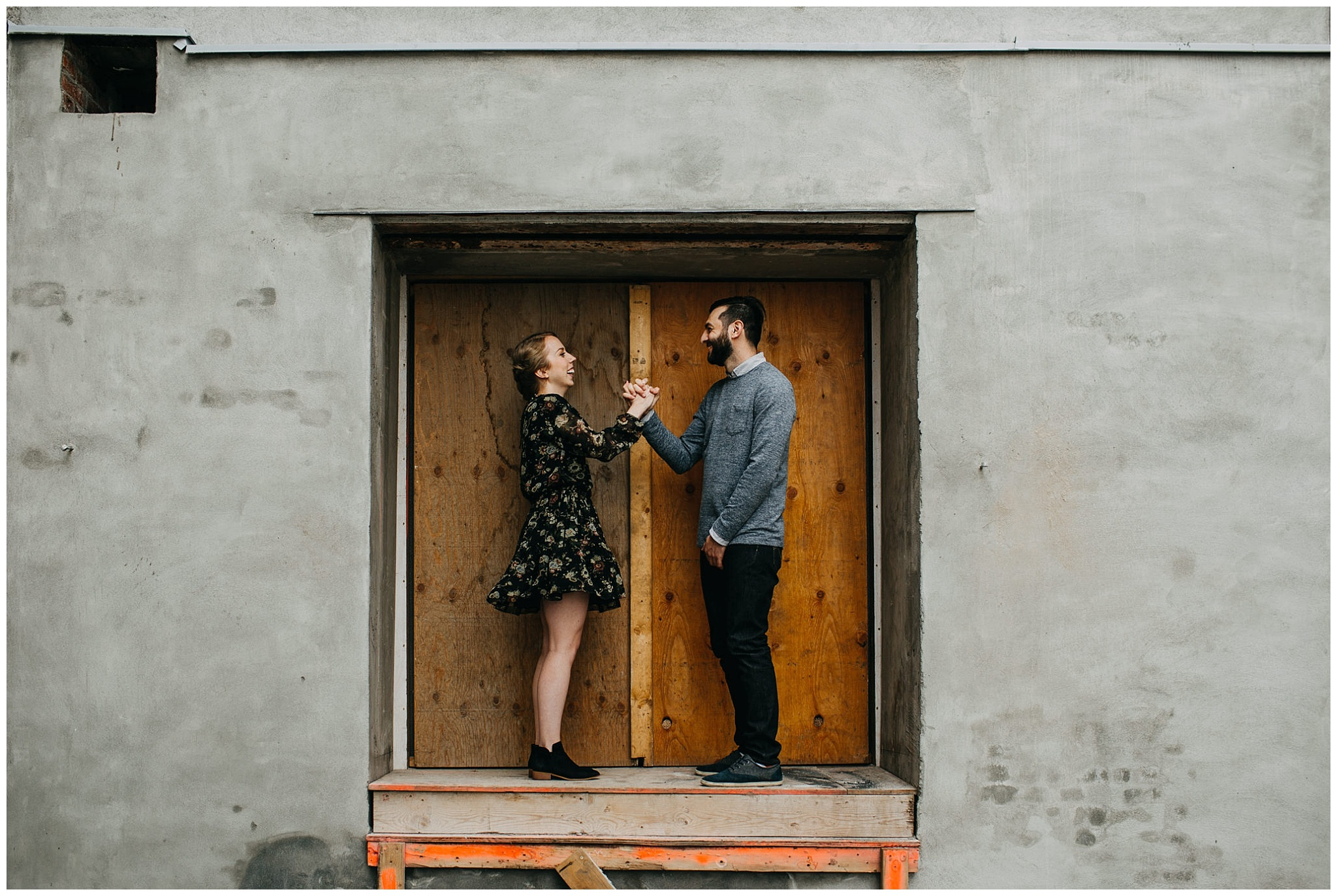 artistic couple photo at urban downtown new west engagement session