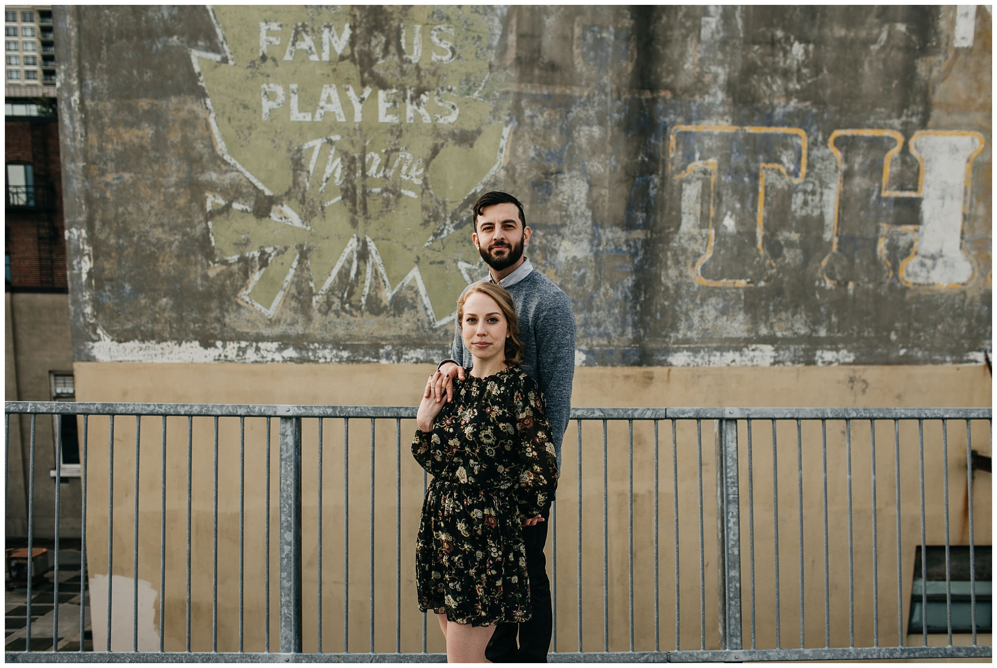 couple on rooftop parkade at downtown new west engagement session