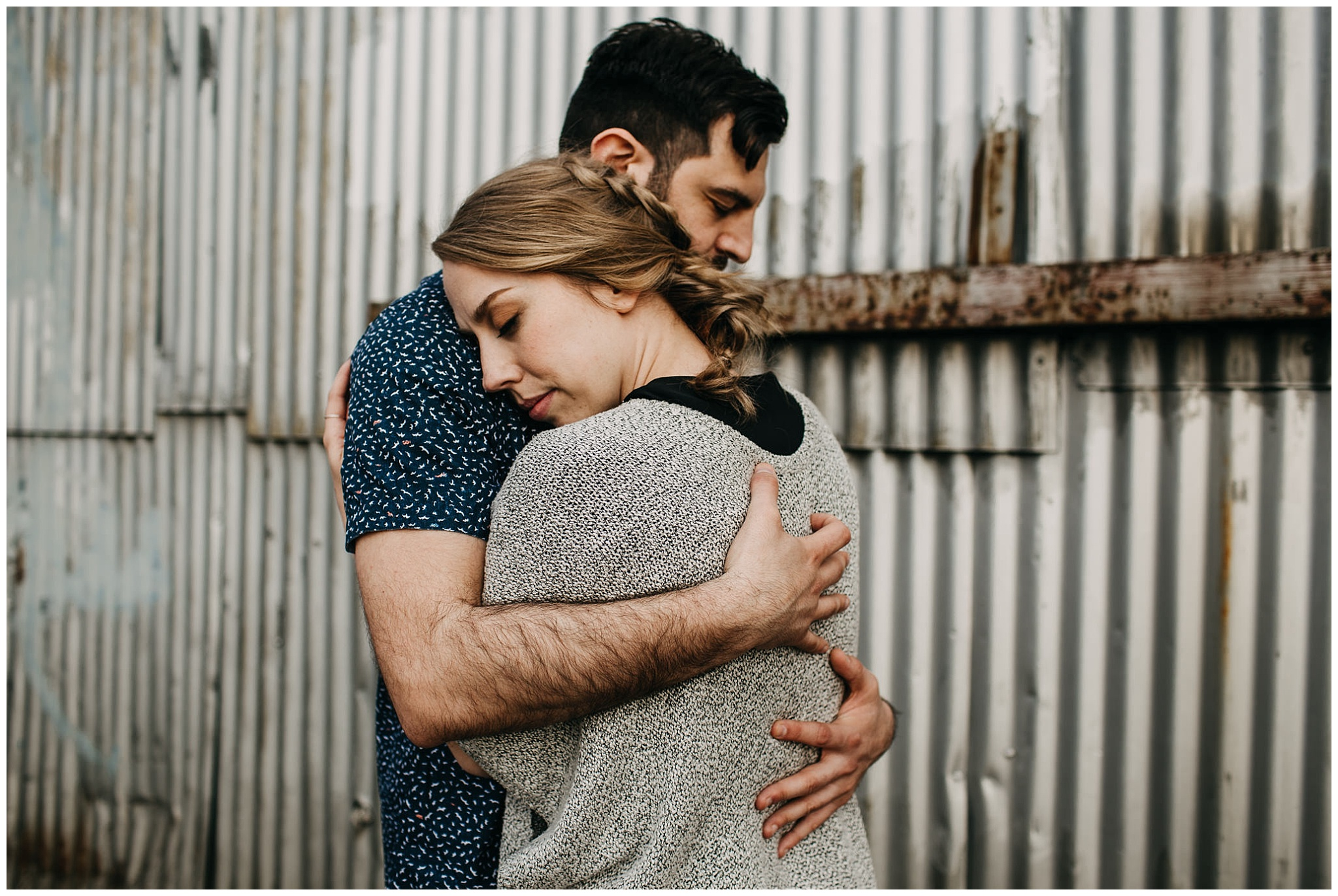 intimate couple photo in industrial setting at downtown new west engagement session
