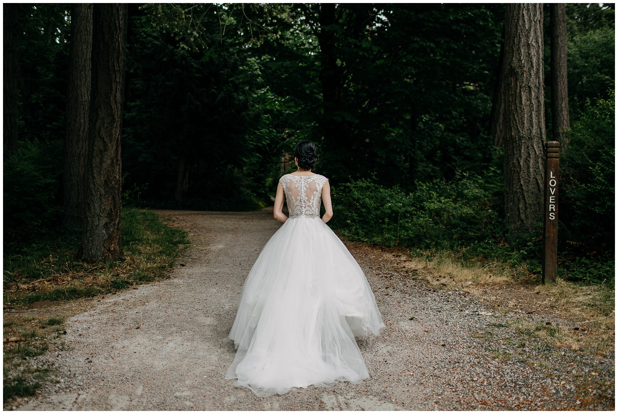 bride walking in the forest to first look at stanley park wedding