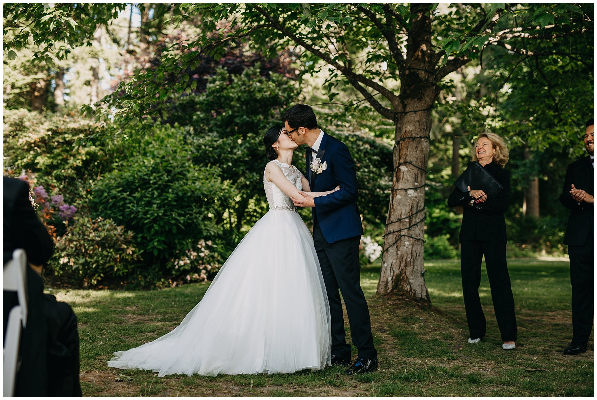 bride and groom first kiss at stanley park teahouse wedding