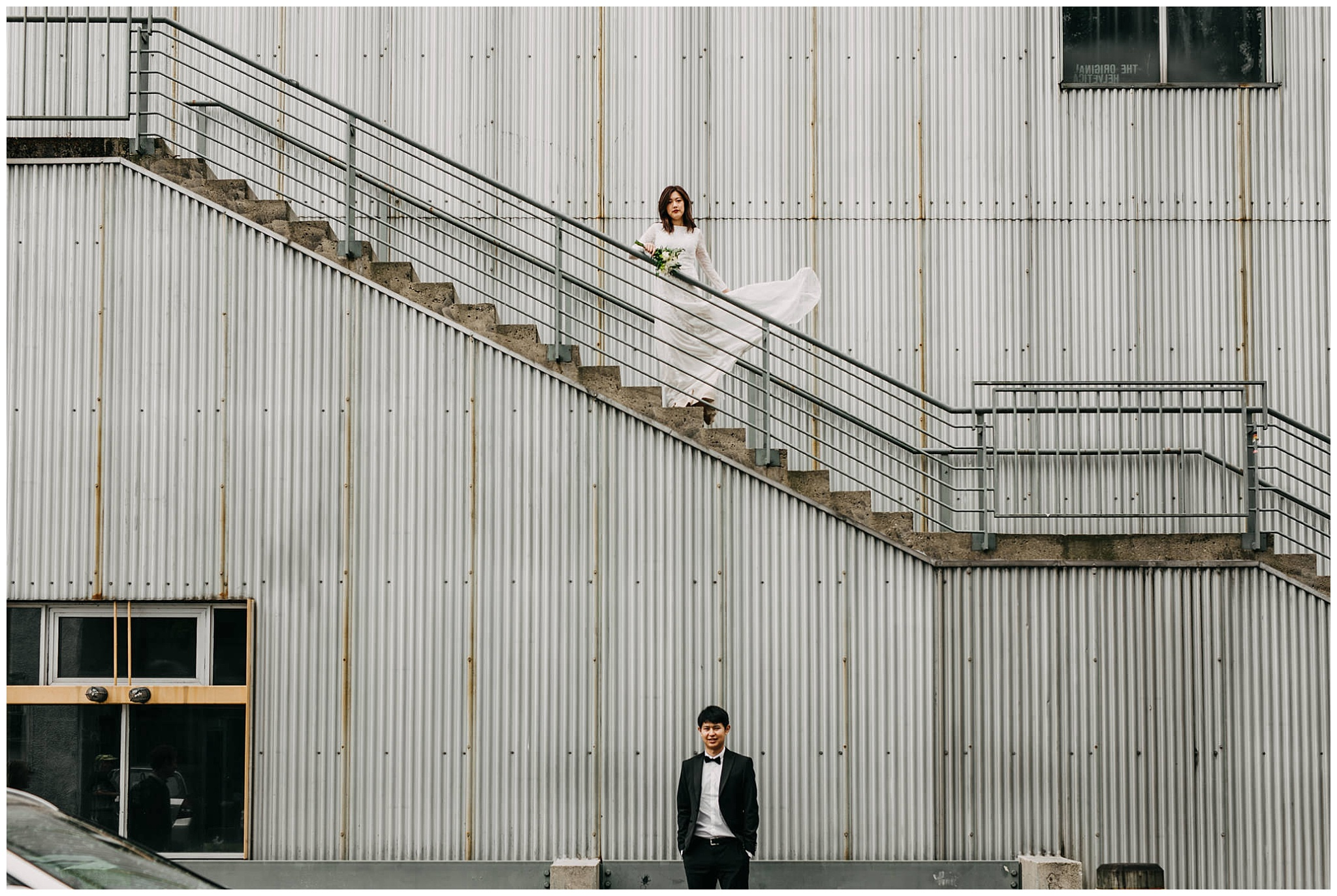 bride and groom portrait on stairs at granville island