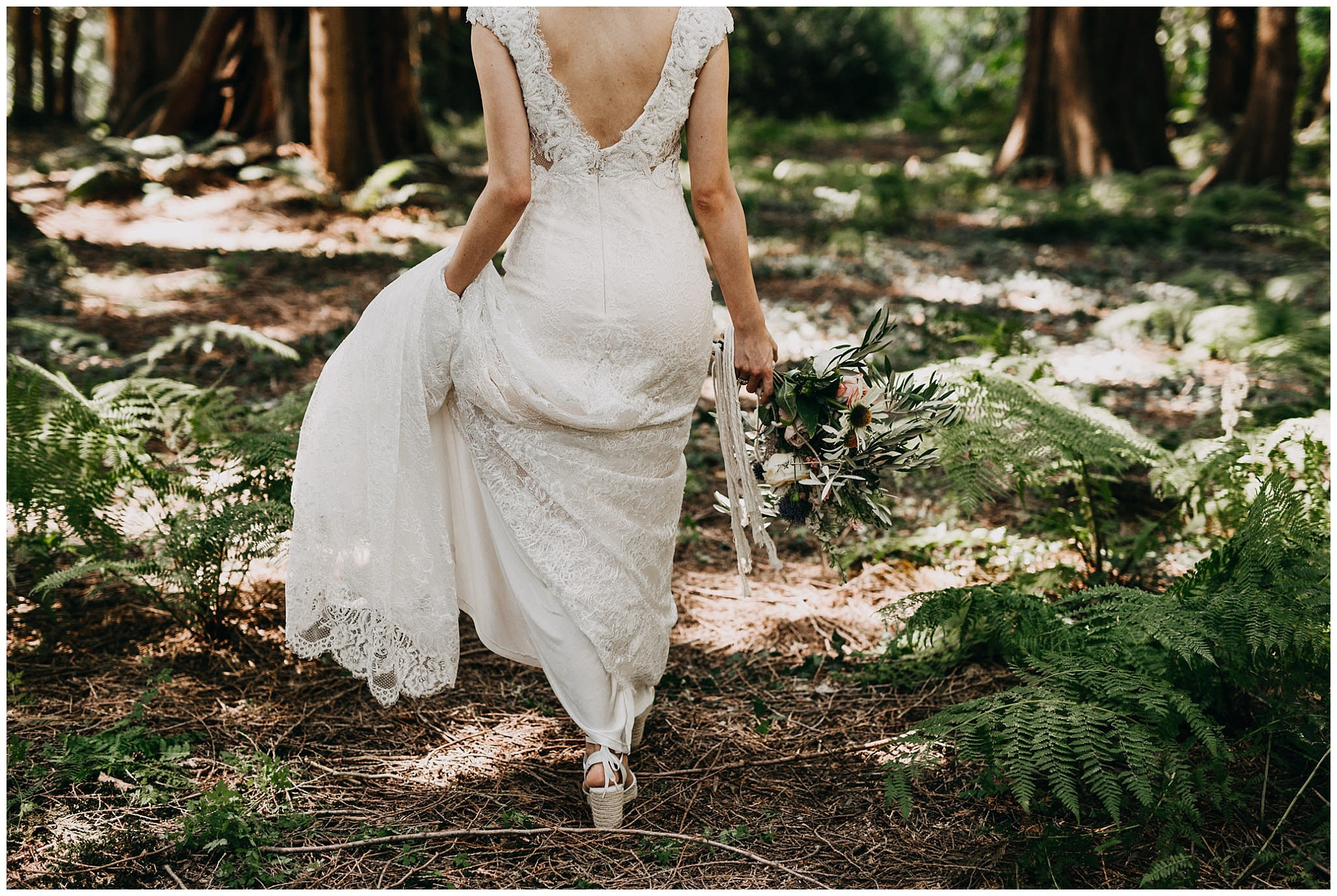 bride walking in forest at krause berry farm wedding