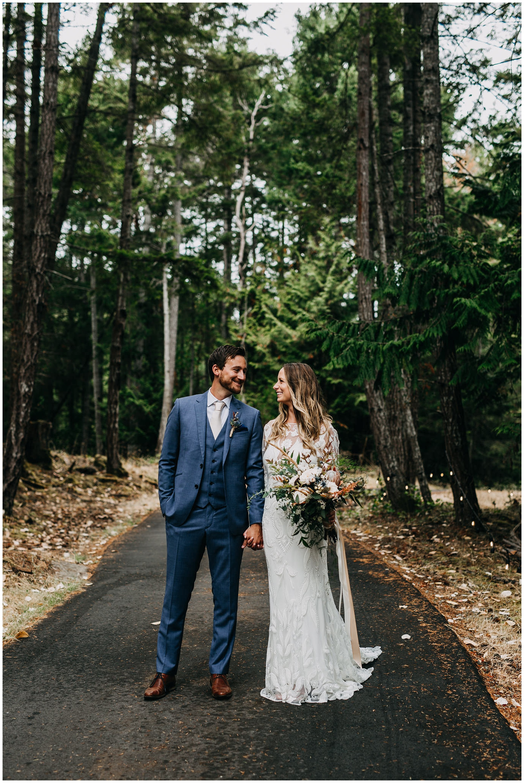bride and groom portrait in trees at mayne island backyard wedding