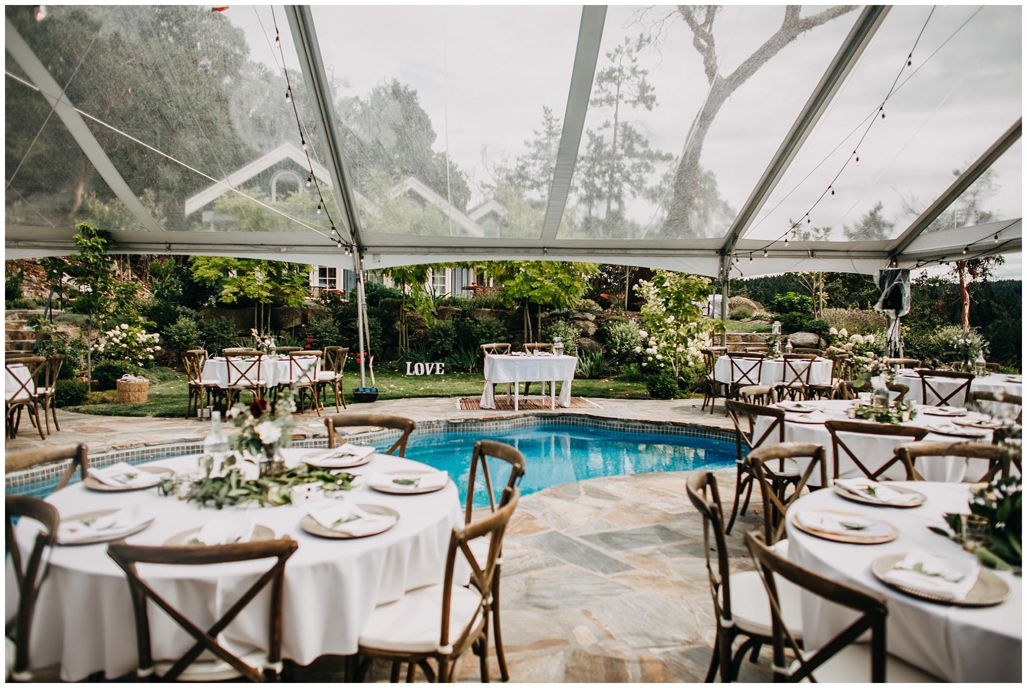 intimate mayne island backyard wedding reception decor by pool