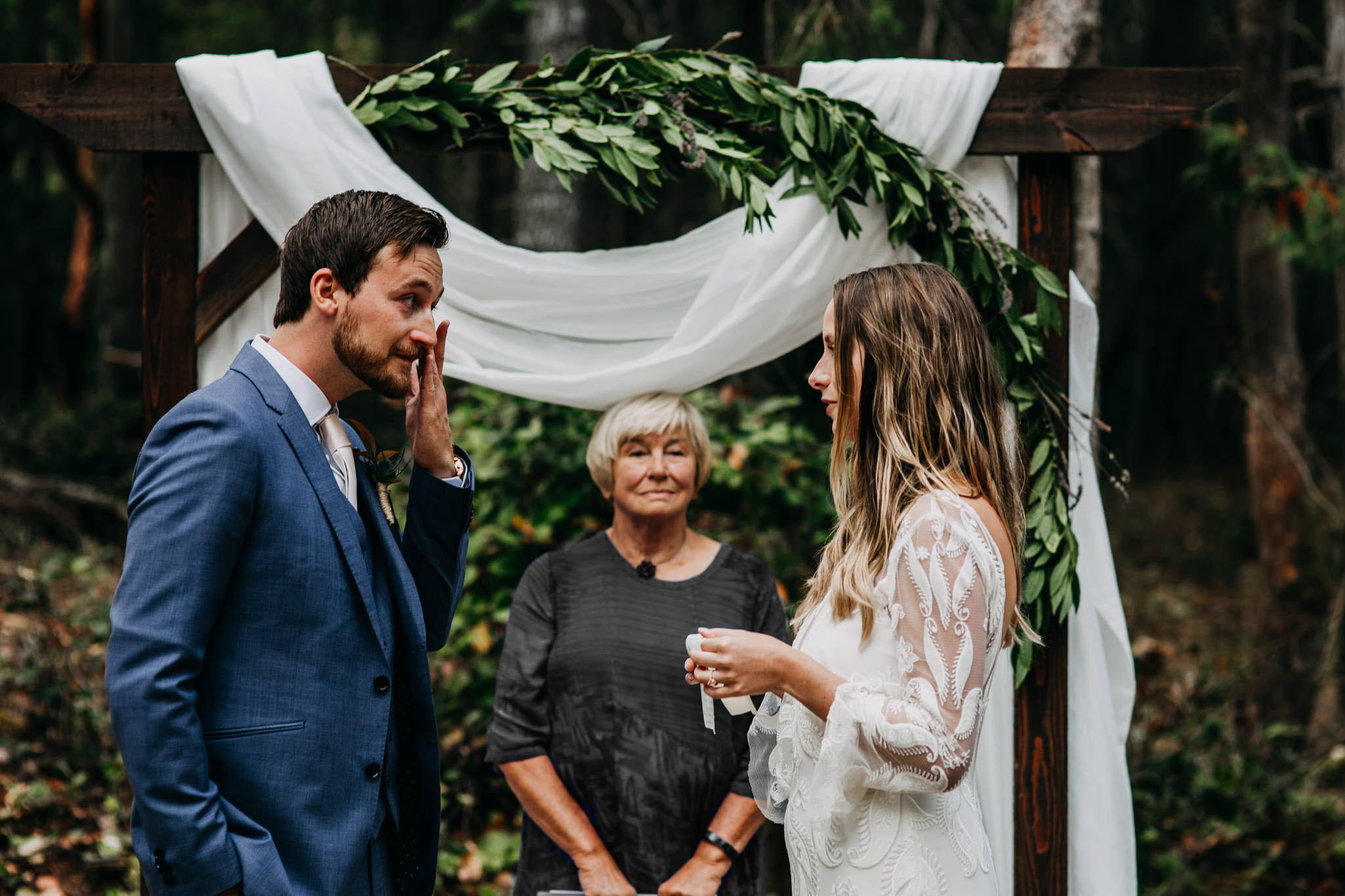 groom crying during vows at intimate mayne island backyard wedding