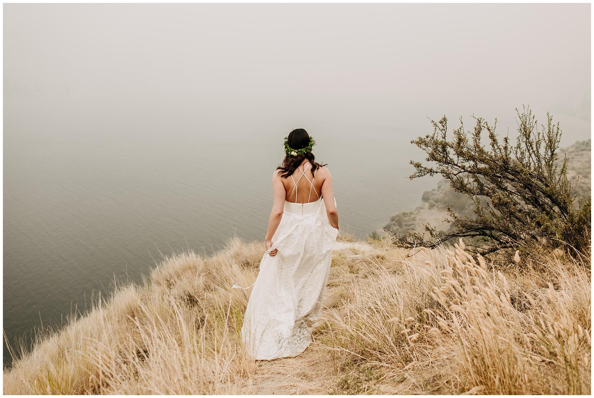 bride walking to viewpoint at linden gardens wedding in kelowna