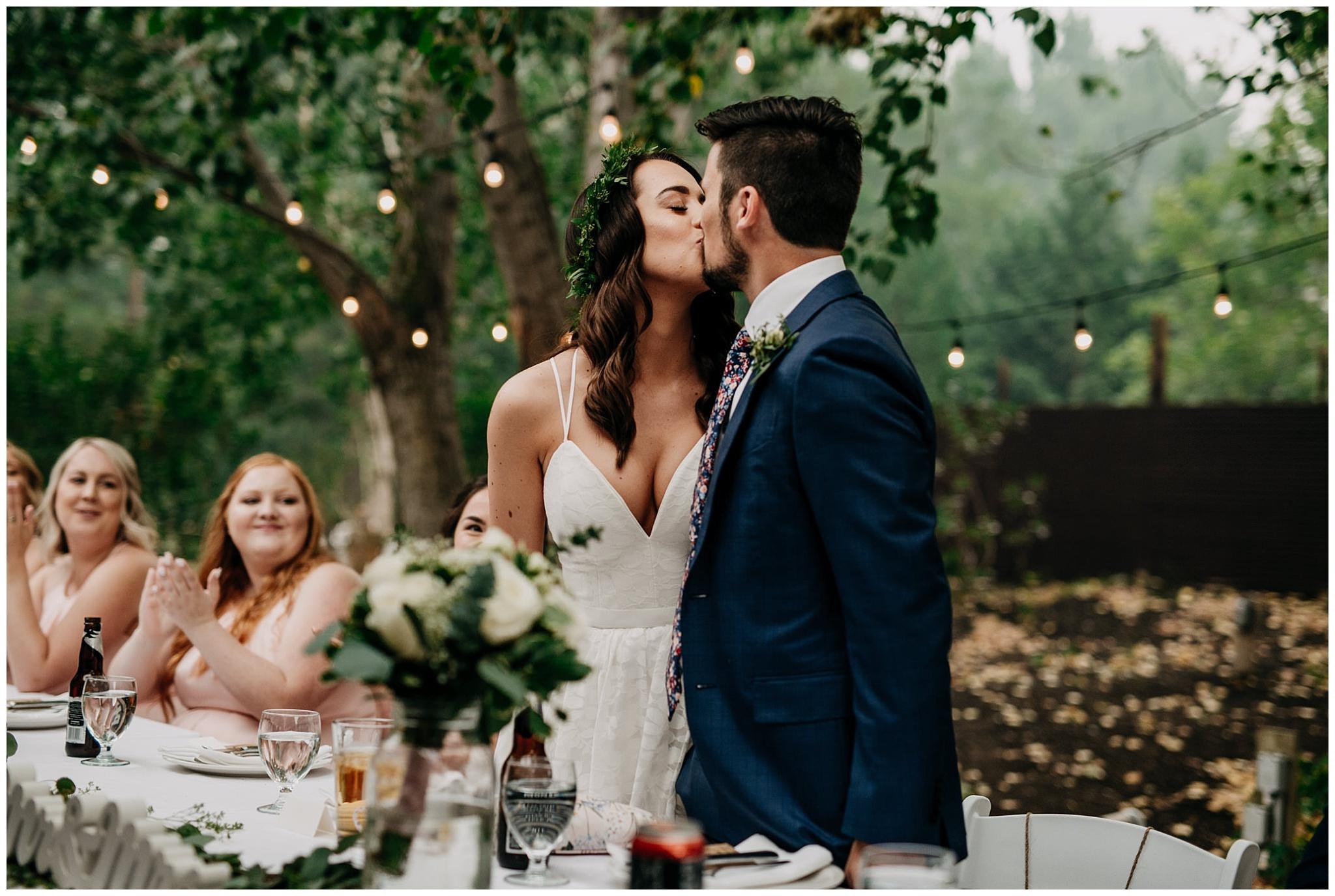 bride and groom kiss at linden gardens wedding