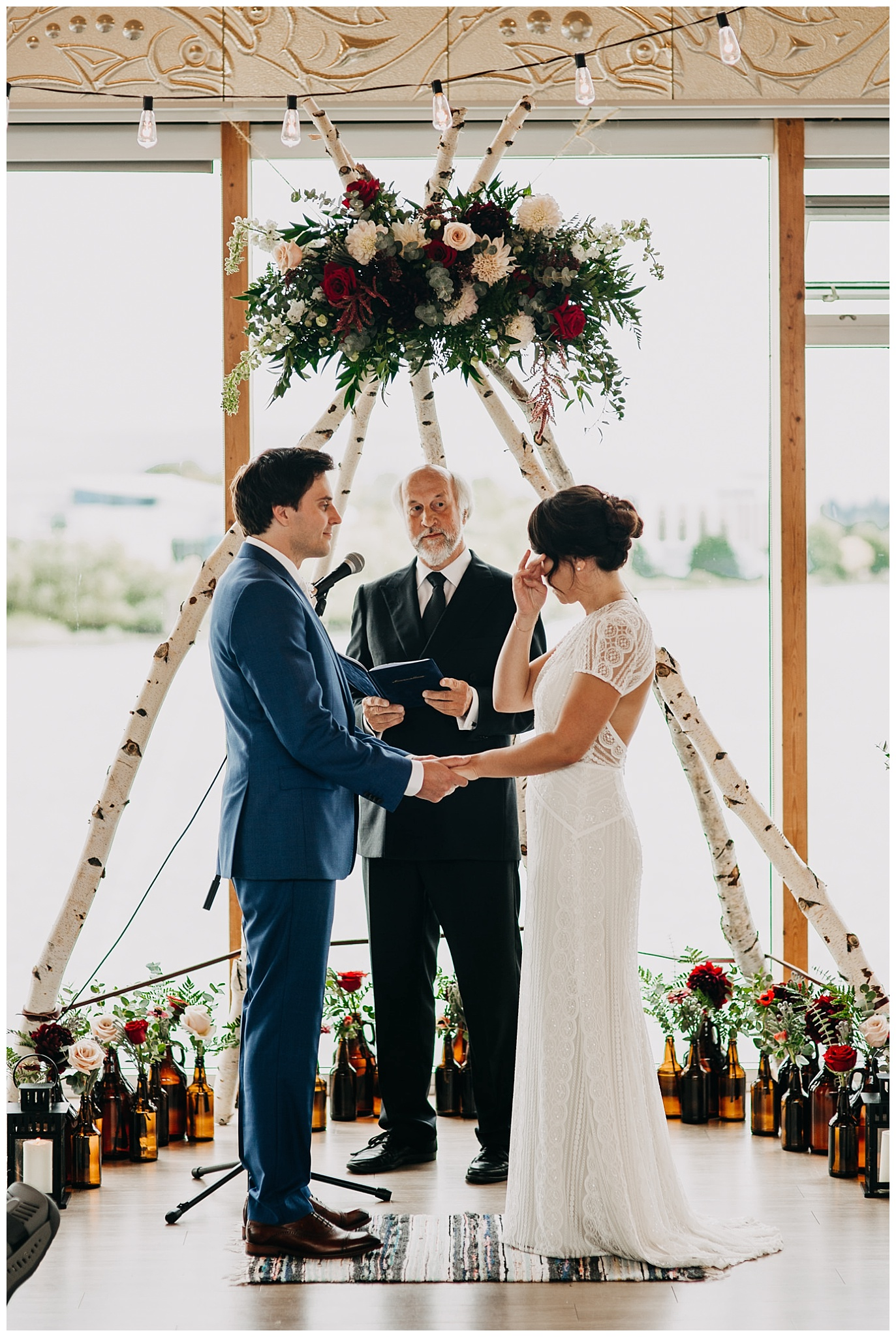 bride and groom emotional moment at ubc boathouse wedding ceremony