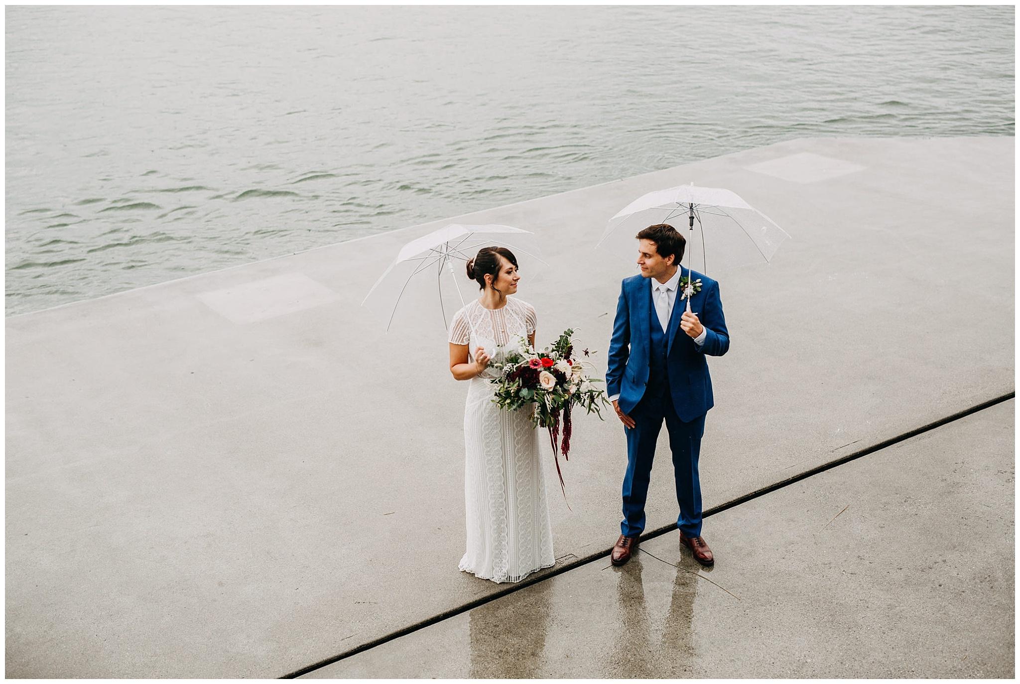bride and groom rainy portrait at ubc boathouse wedding