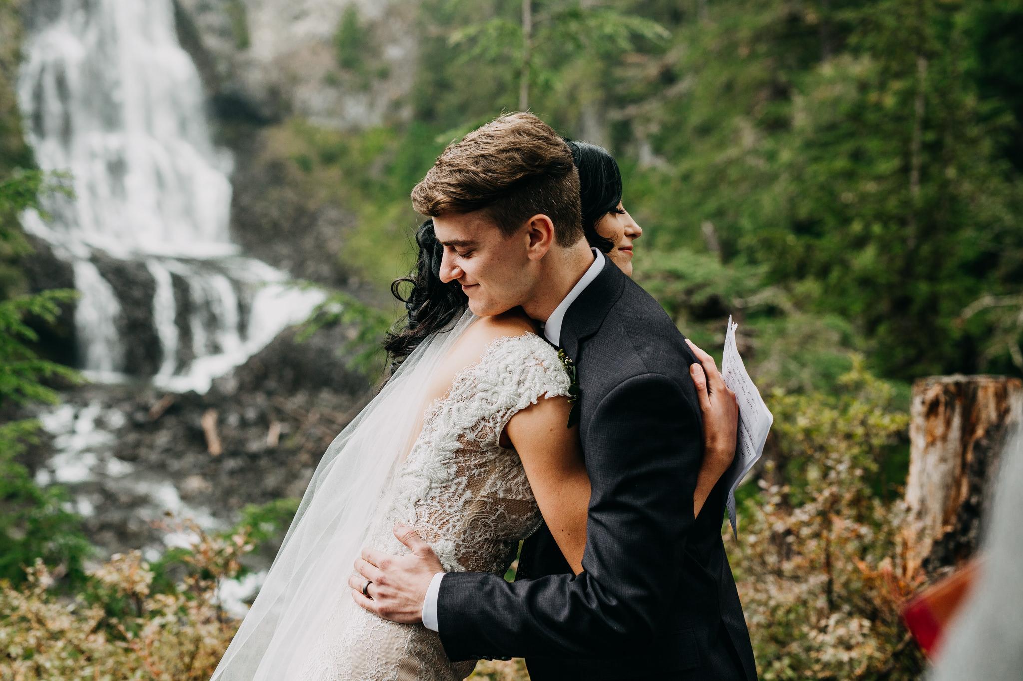bride and groom hugging at whistler elopement
