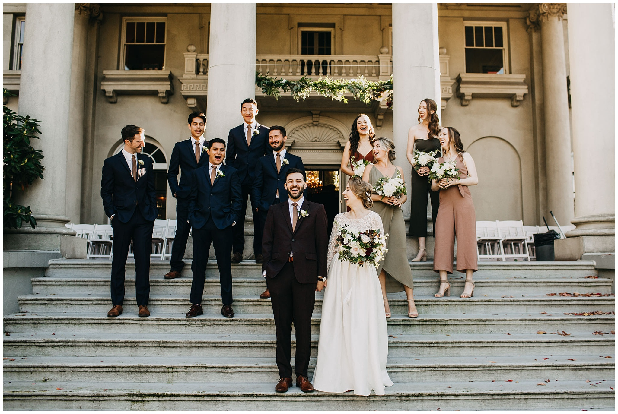 wedding party portrait on stairs at hycroft manor wedding