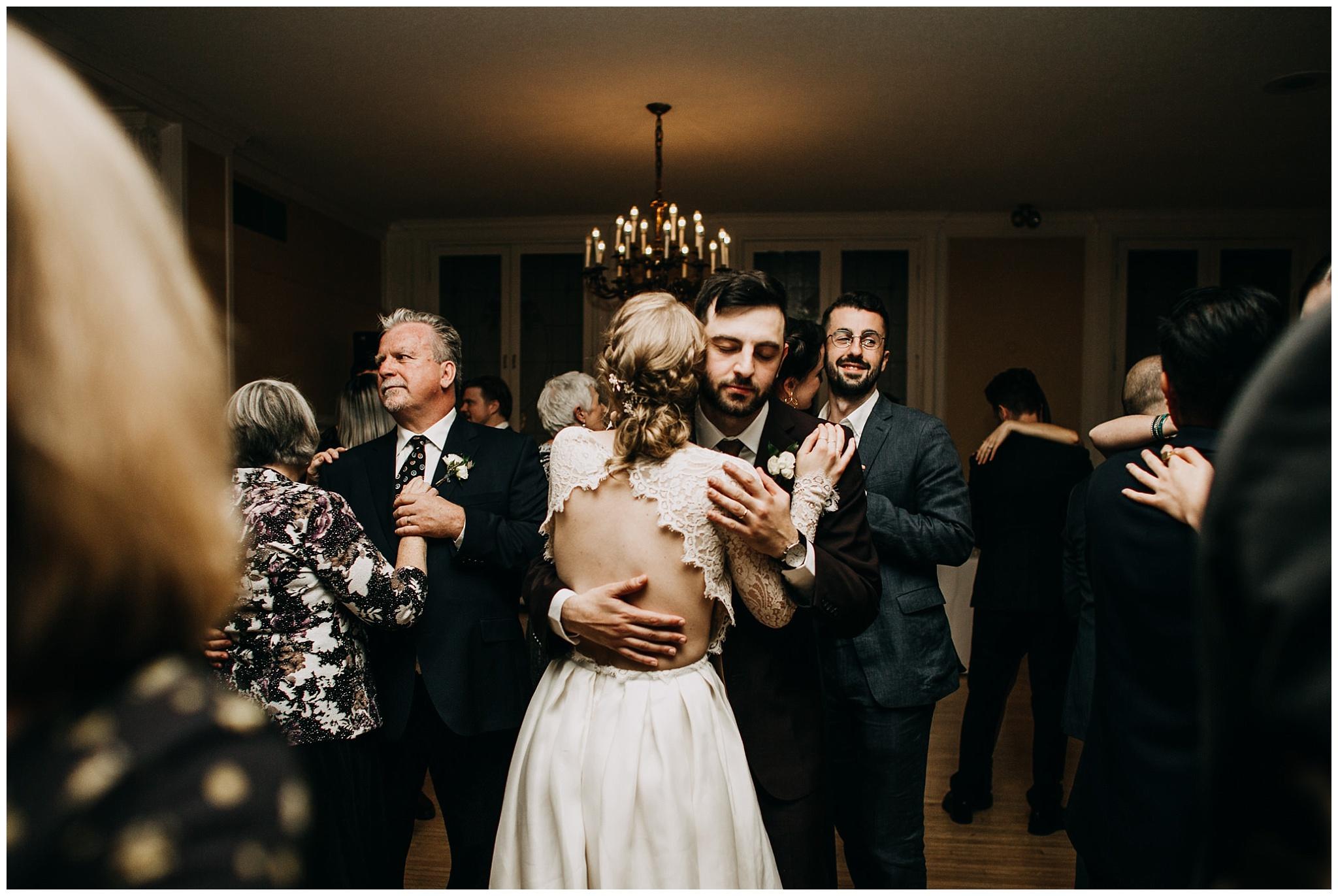Bride and groom slow dancing on dance floor at Hycroft Manor wedding