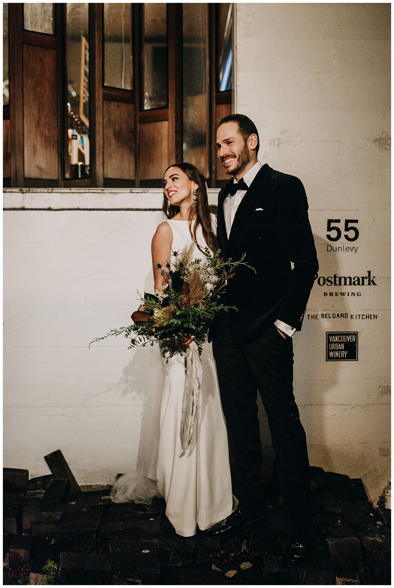 bride and groom wedding portrait outside Postmark Brewing