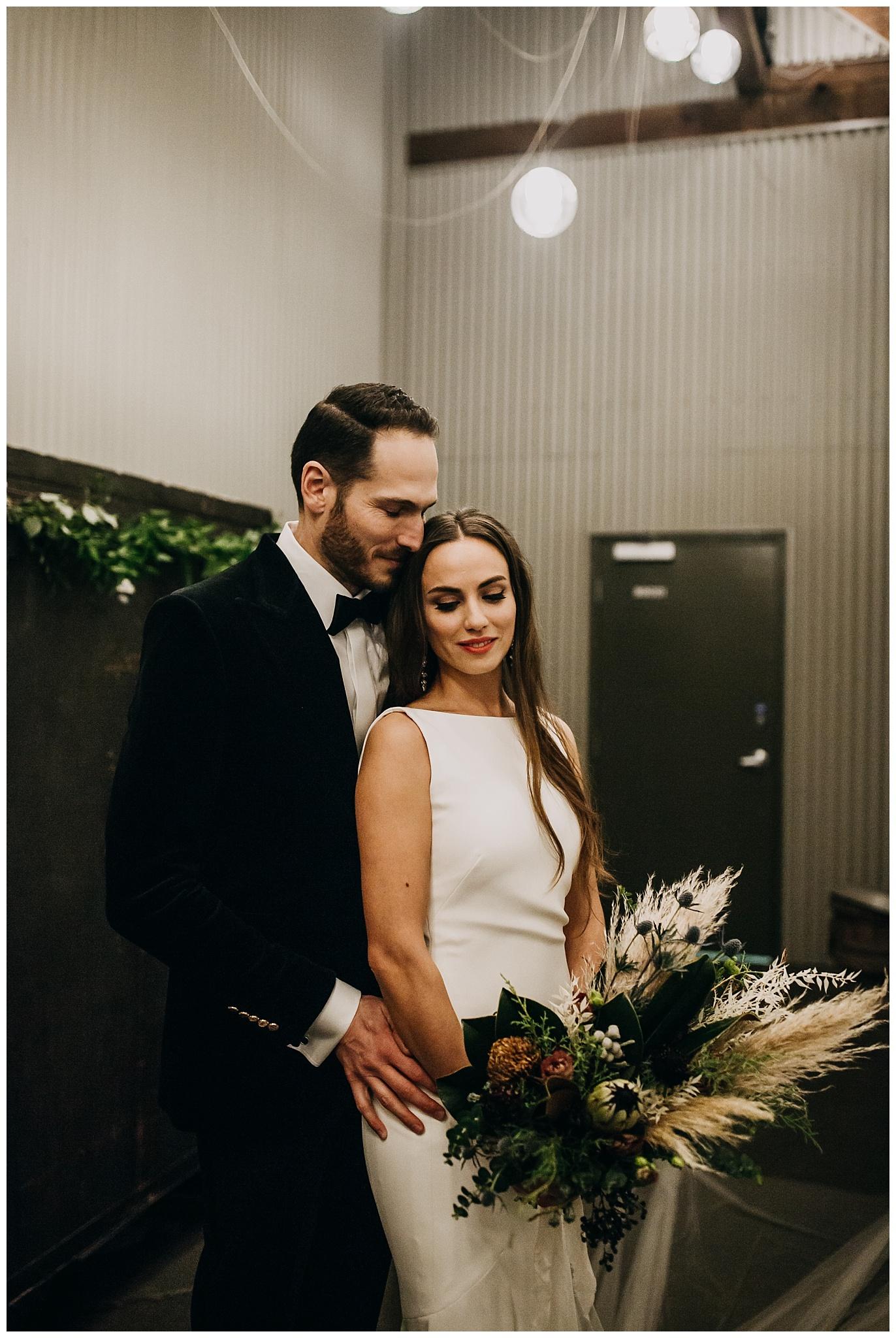 bride and groom wedding portrait inside settlement building