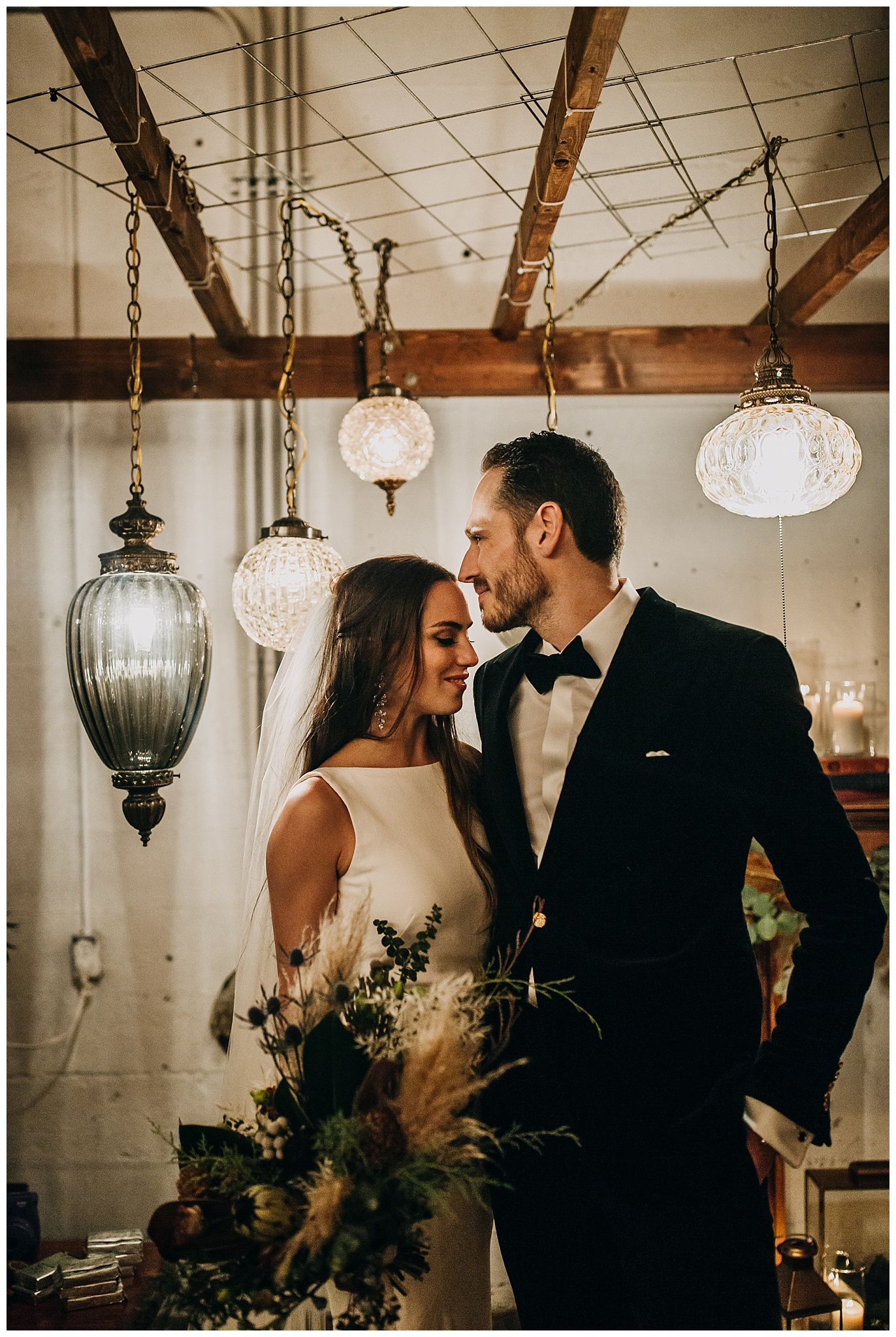 bride and groom portrait with lanterns at settlement building