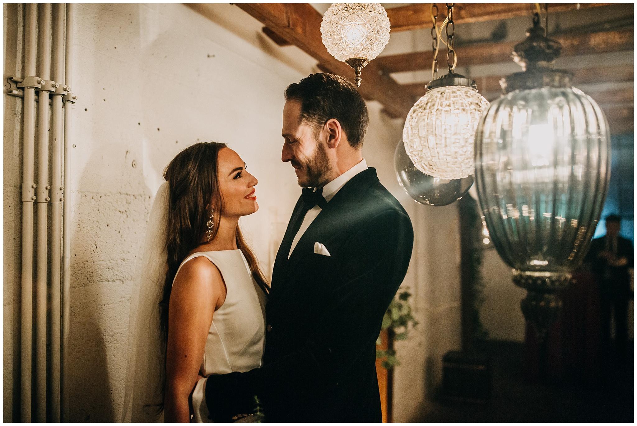 bride and groom indoor portrait at settlement building wedding