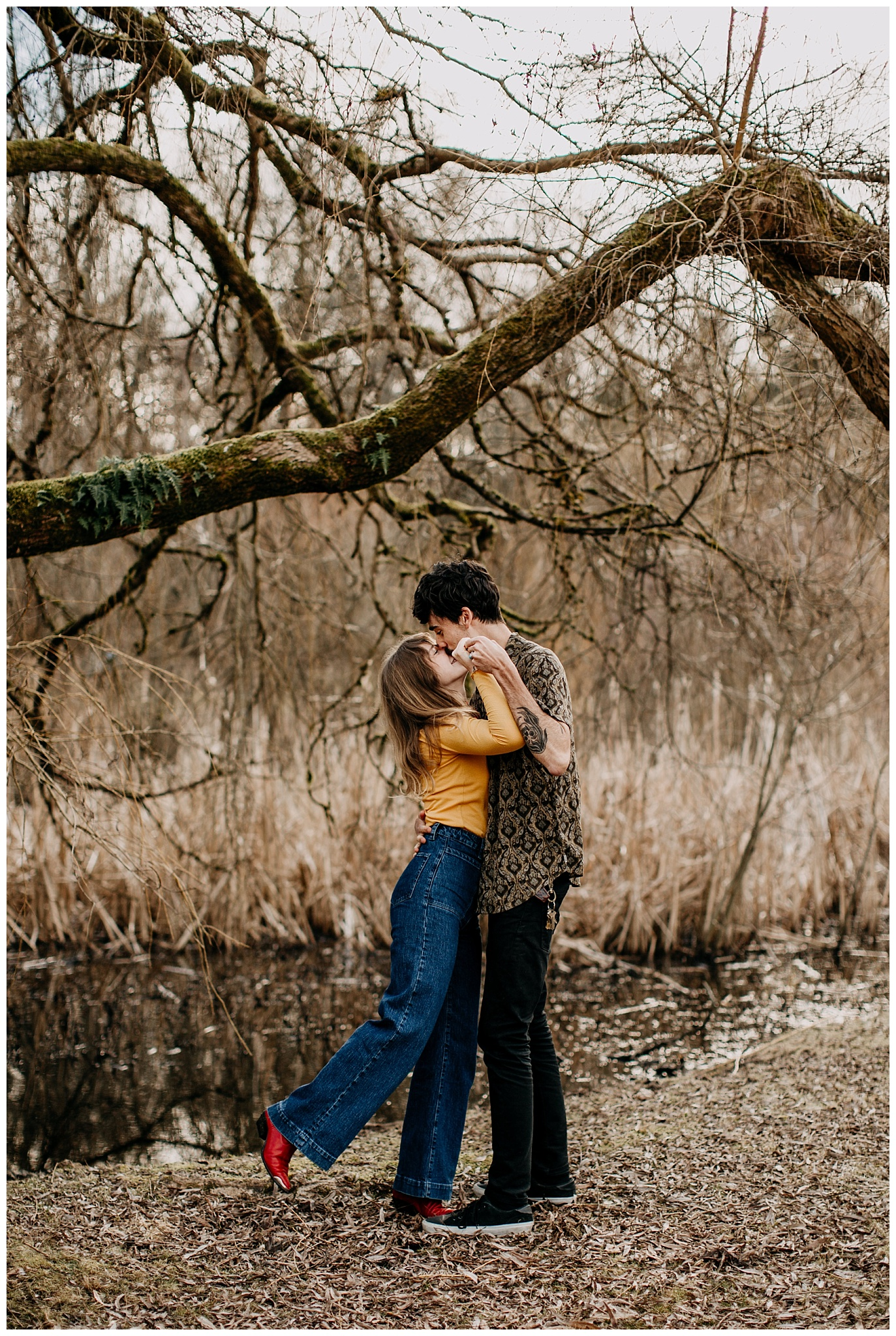 couple dancing at 70s inspired engagement session at jericho beach