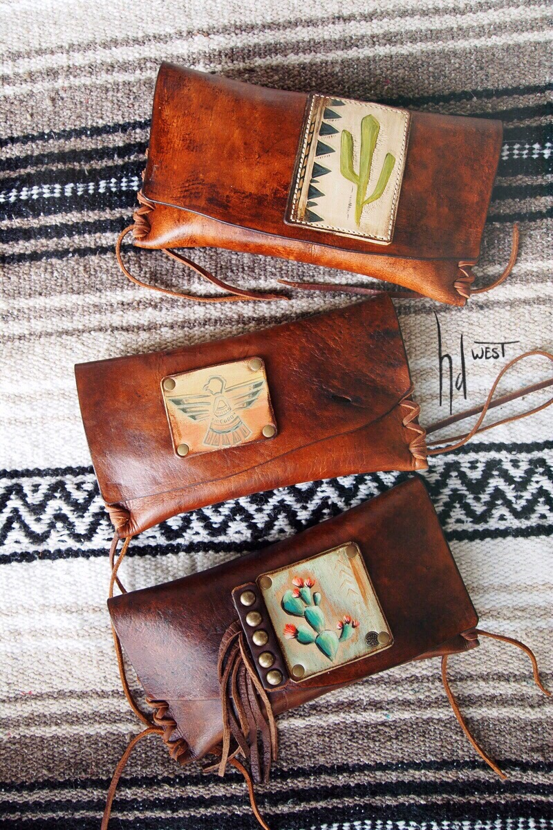 clutch wallets - small enough to use as a wallet but big enough for some lipstick, cards & a phone for a night out. Snap closure.these measure approx: 8