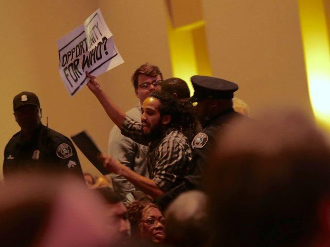 Antonio Cosme disrupting Mayor Duggan's State of the City address. Photo Credit: Julia Cuneo