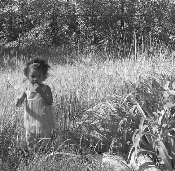Mr. and Mrs. Turner's great great granddaughter in a field on their block in 2017.