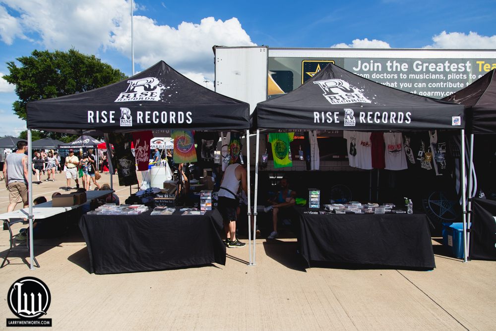 The Rise Records merch tents.