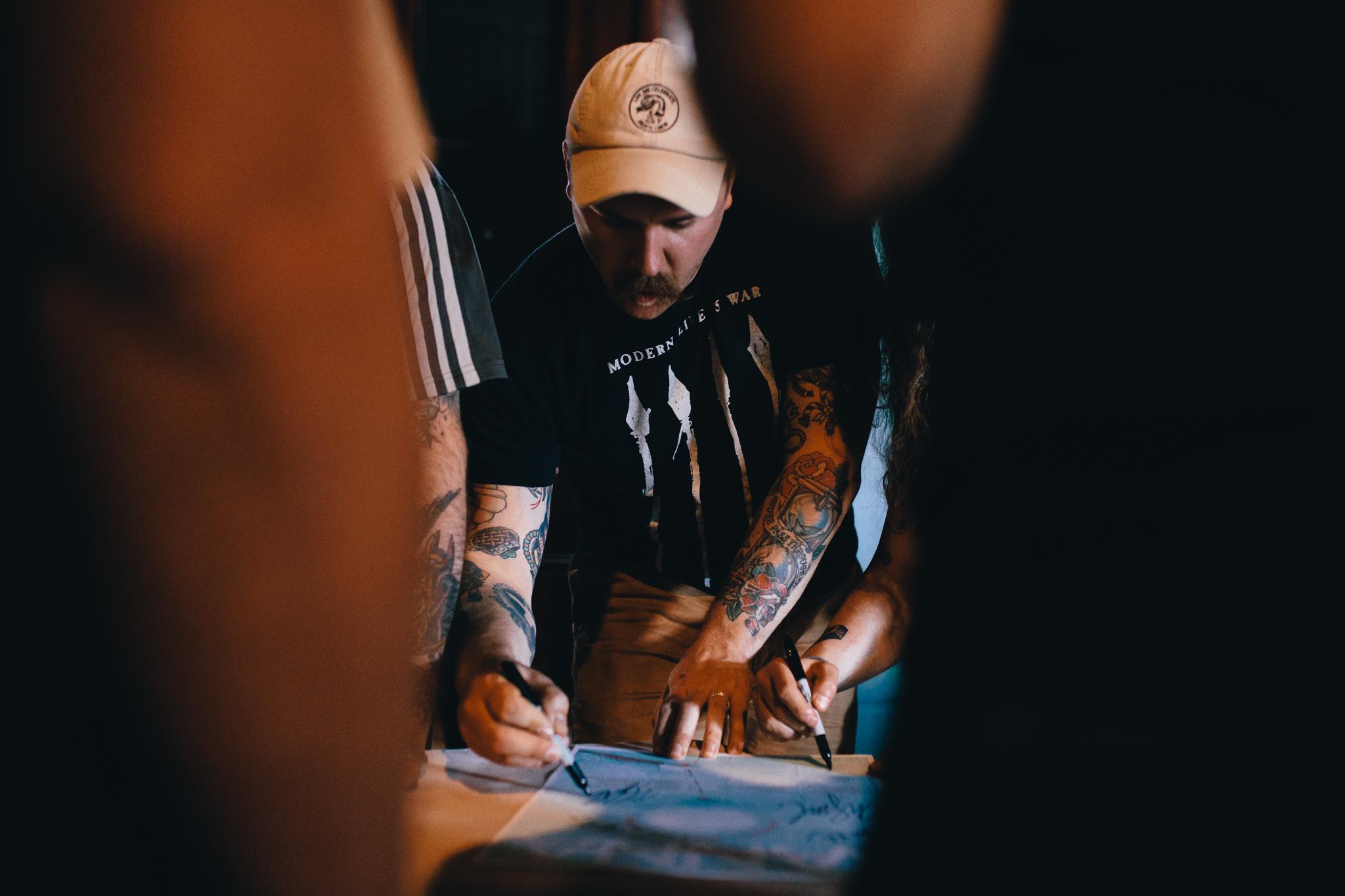 Shawn signing a T shirt